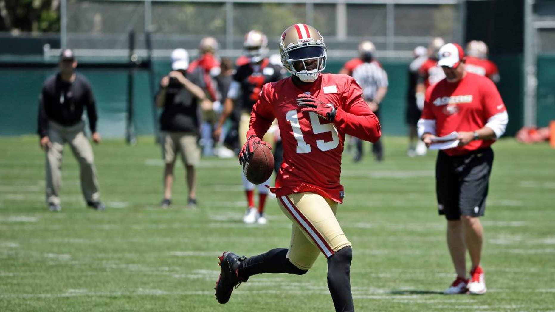 FILE - In this May 28, 2014, file photoo, San Francisco 49ers wide receiver Michael Crabtree runs after a reception during an NFL football pracice in Santa Clara, Calif. Crabtree has been looking forward to this for six seasons _ his first NFL game in his Dallas home. That chance comes Sunday in San Francisco's opener. And the star wide receiver is not about to let a calf injury stand in his way.  (AP Photo/Marcio Jose Sanchez, File)
