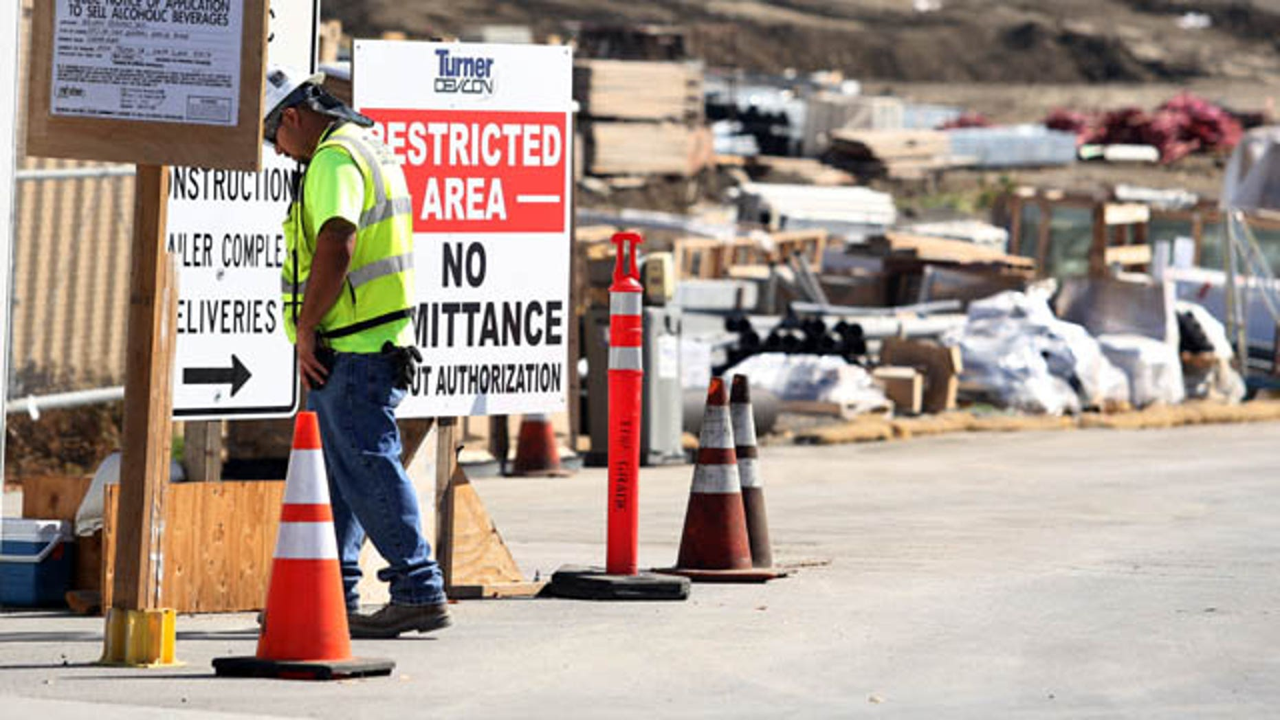 October 14, 2013: A security guard walks by a construction entrance at the Forty-Niners' new stadium Monday, Oct. 14, 2013, in Santa Clara, Calif., where a second worker has been killed in an accident in less than four months. (AP Photo)