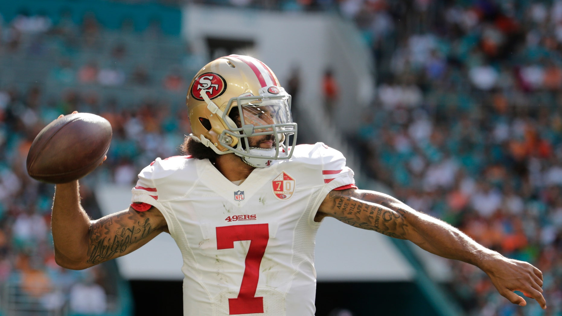 San Francisco 49ers quarterback Colin Kaepernick looks to pass during a game against the Miami Dolphins.