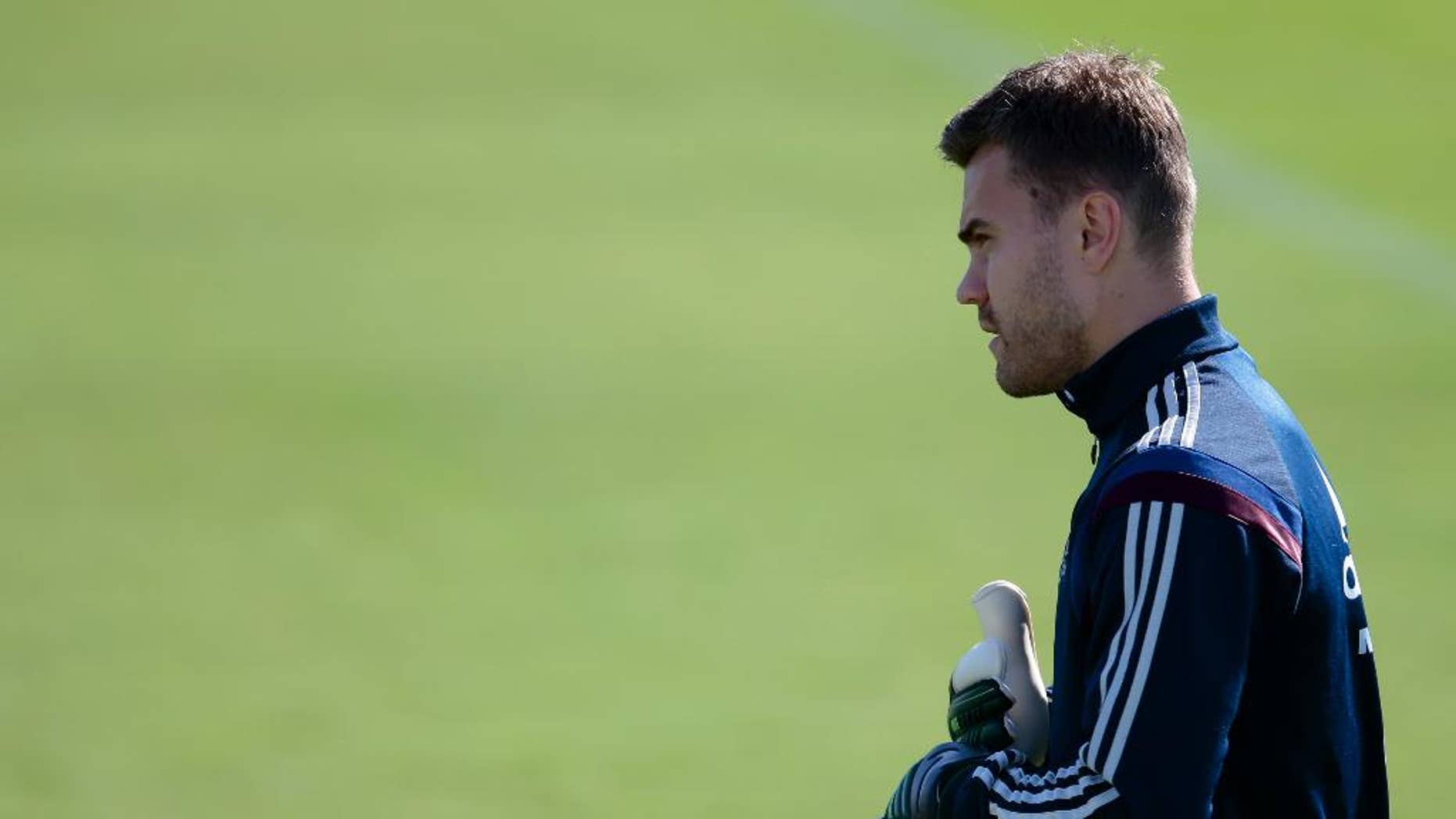 Goalkeeper Igor Akinfeev looks at a ball during Russian national soccer team training session in Itu, Brazil, on Thursday, June 19, 2014. Russia will play next game against Belgium in group H of the 2014 soccer World Cup. (AP Photo/Ivan Sekretarev)