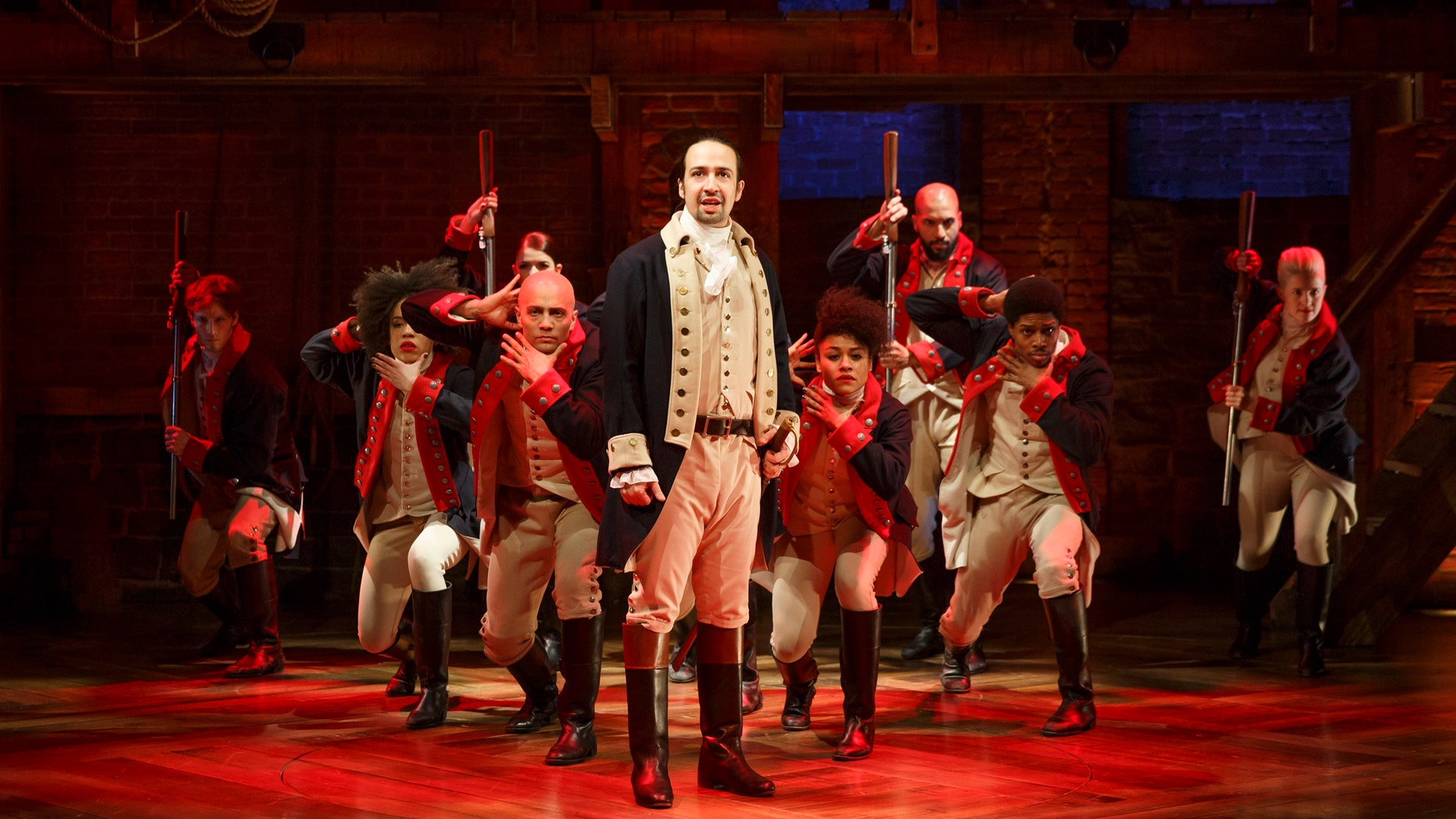 "Lin-Manuel Miranda, center, performs in the musical ""Hamilton"" at The Public Theater in New York."