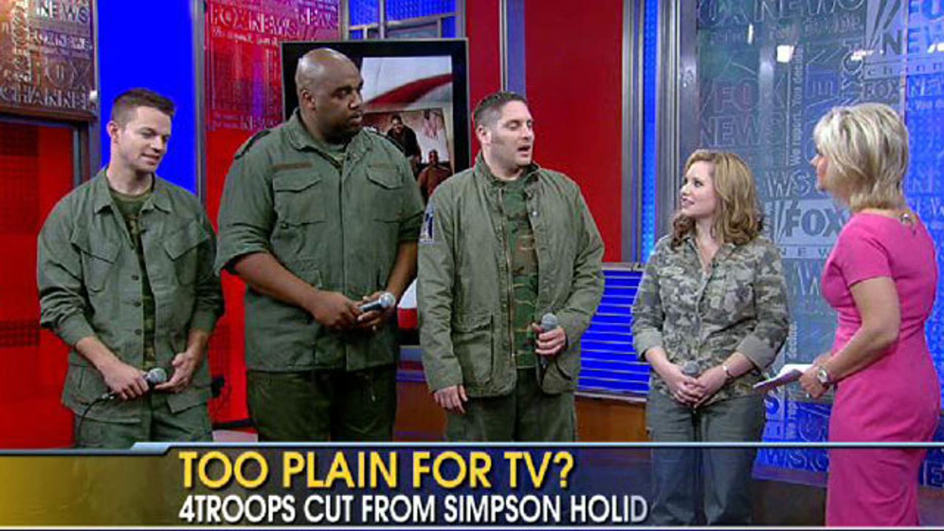 Singing quartet 4Troops says producers for Jessica Simpson's holiday special snubbed them because they didn't wear tuxedos for their performance with the singer.
