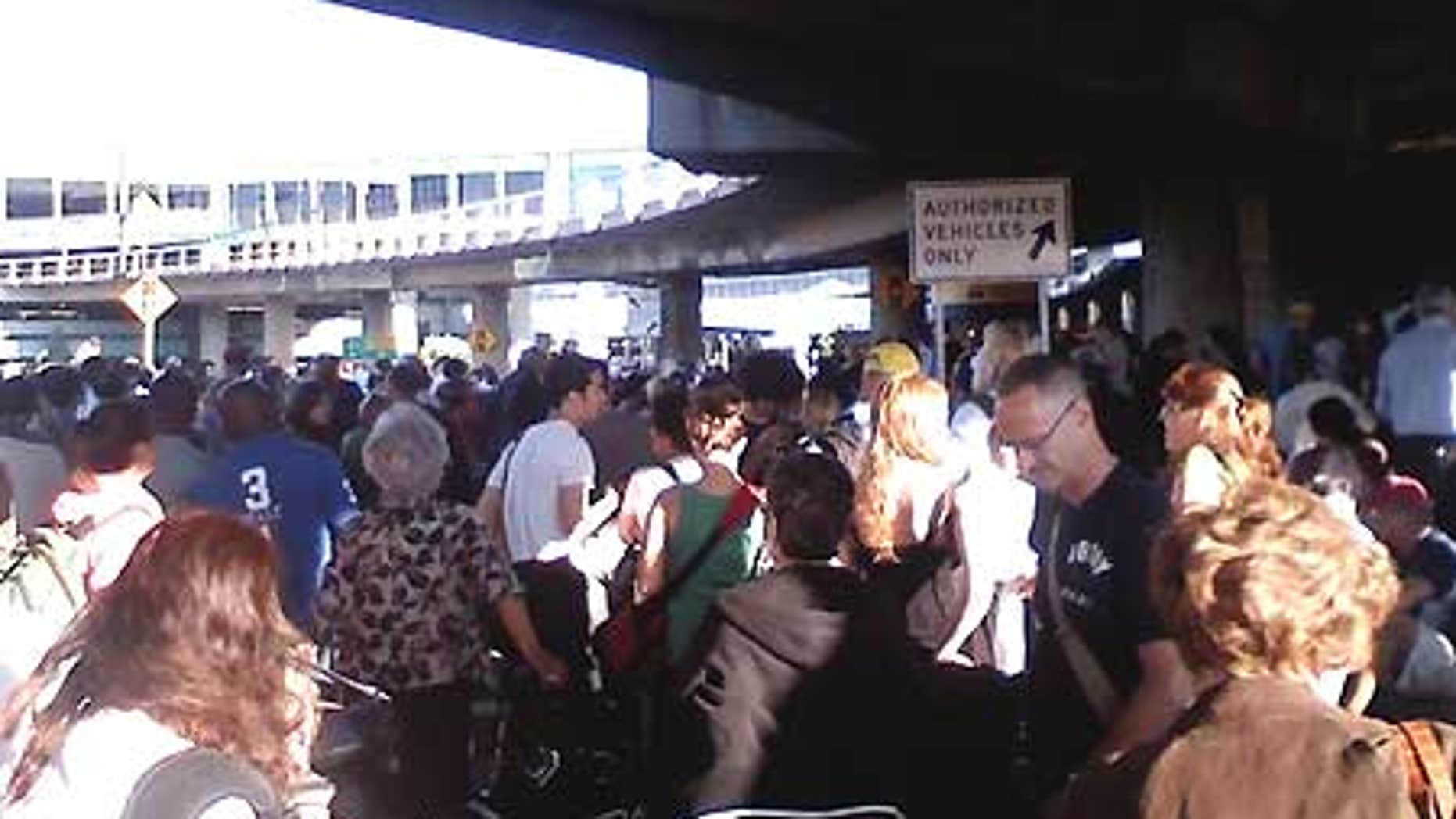 Aug. 1: The main terminal in New York City's LaGuardia Airport was evacuated Saturday morning after a man carrying a fake bomb in his bag was stopped.