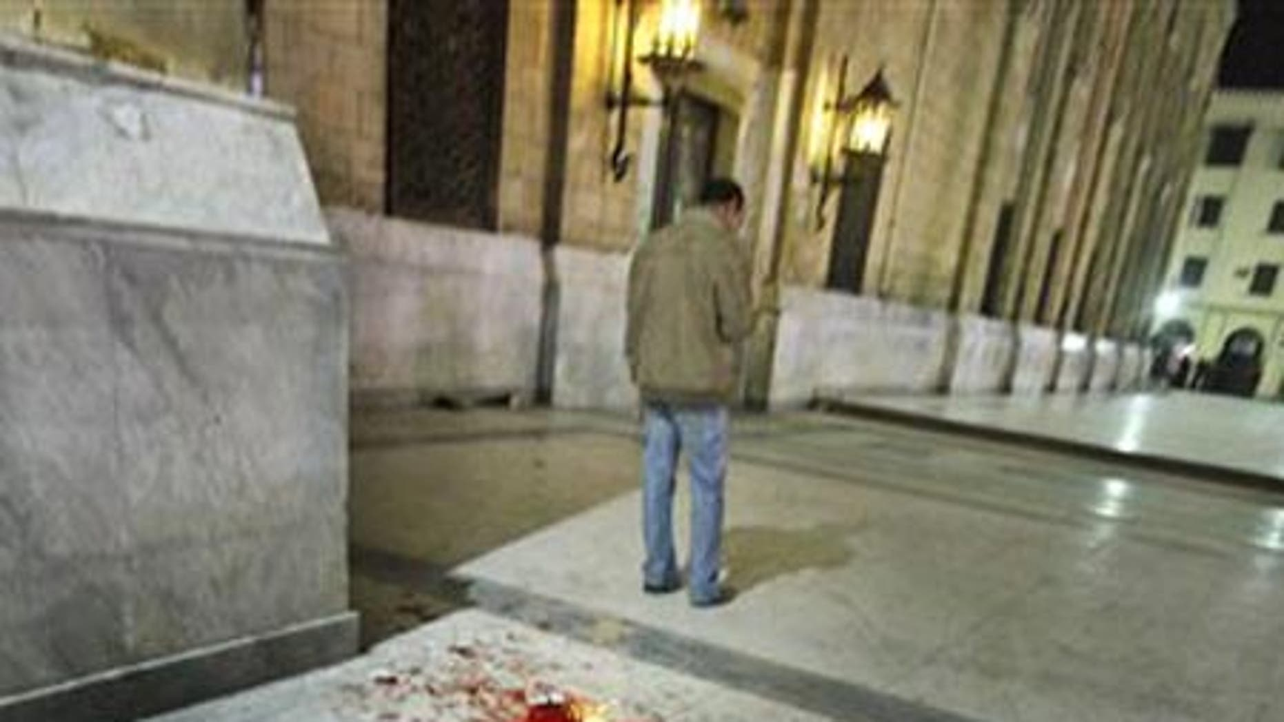 Feb. 22: Blood is seen on the ground following a bomb blast outside the Al-Husseini mosque.
