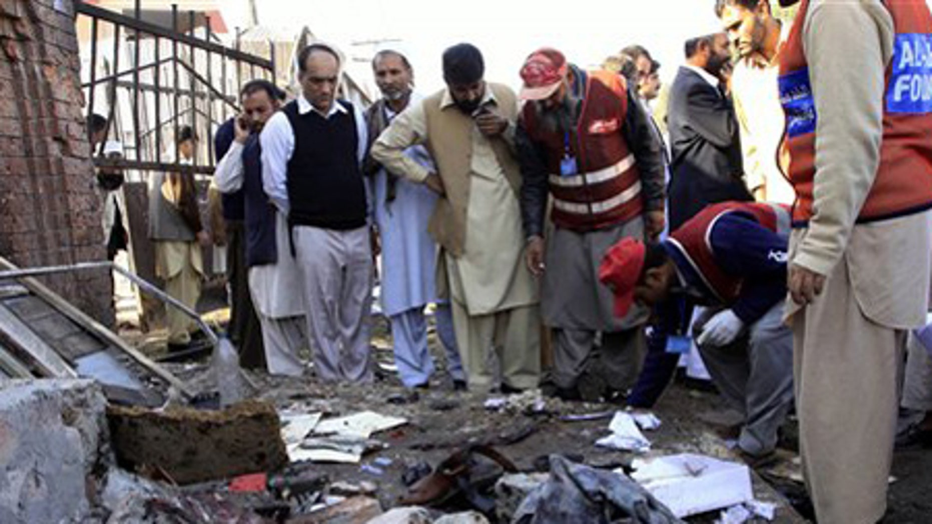 Nov. 19: People gather at the spot of a homicide bombing outside a courthouse in Peshawar, Pakistan.