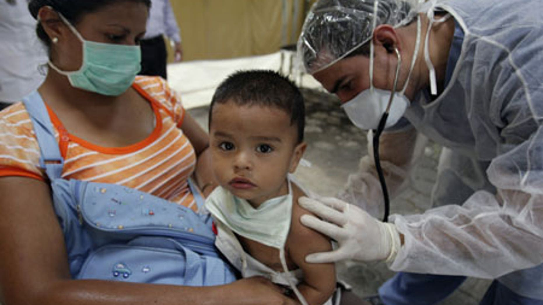 June 2, 2009: A doctor checks on a child suspected of having H1N1 at a mobile clinic in the Children's Hospital in Nicaragua.