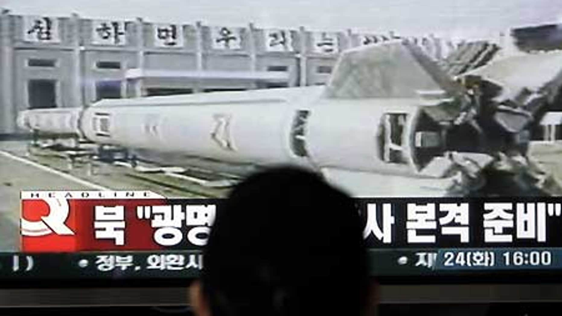 Feb. 24: A South Korean watches television news showing a file image of North Korea's missile, at a railway station in Seoul.