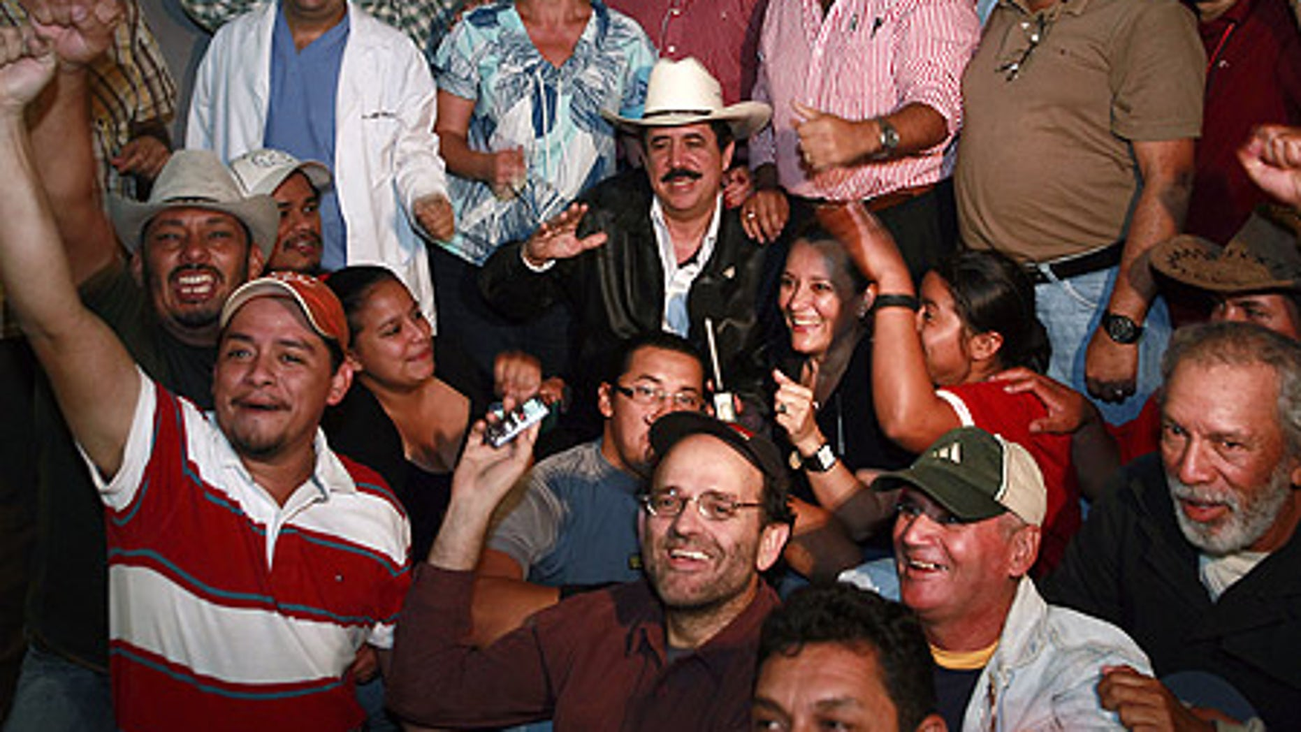 Oct. 30: Honduras' ousted President Manuel Zelaya surrounded by his supporters at the Brazilian embassy in Tegucigalpa.