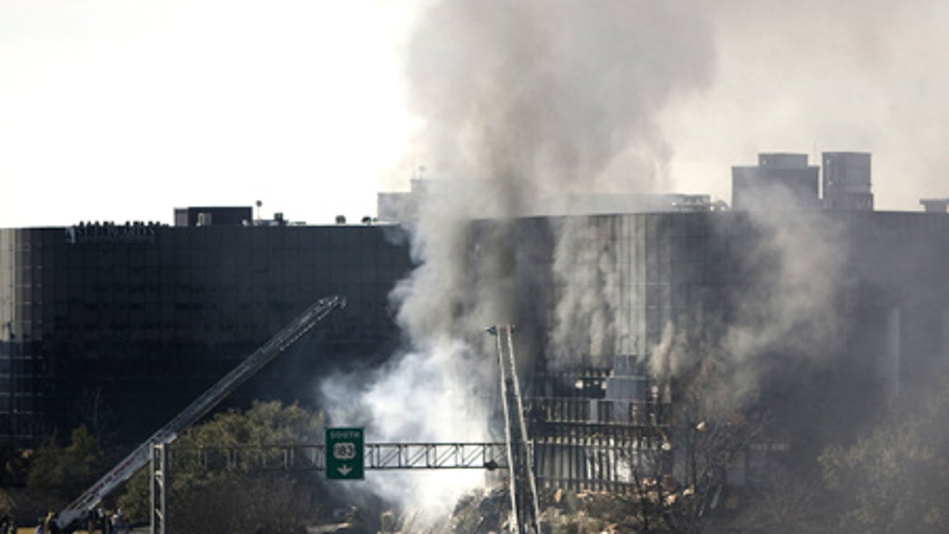 Feb. 18: Smoke billows from a 7 story building after a small plane crashed into it in Austin.