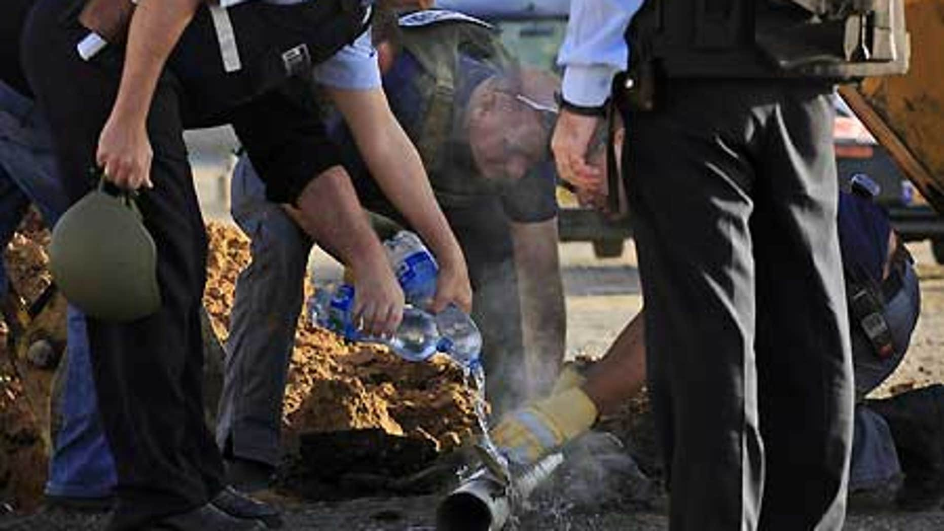 Feb. 3: Israeli police examine the remains of a rocket fired by Palestinian militants from the Gaza Strip, in the southern Israeli city of Ashkelon.