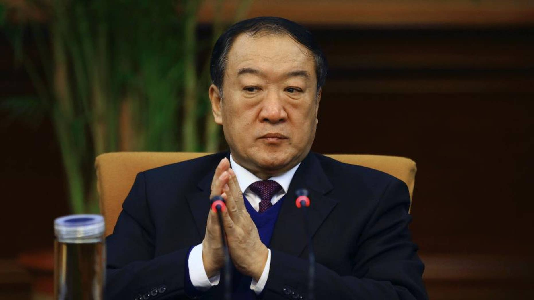 "In this March 6, 2012 photo, Su Rong, ex-vice chairman for the Chinese People's Political Consultative Conference (CPPCC) attends a group session during the National People's Congress in Beijing. Chinese authorities say the former vice chairman for the country's top political advisory body has been expelled from the Communist Party and stripped of all government positions because of bribery. The Central Commission for Discipline Commission, the Communist Party's top watchdog agency, said Monday, Feb. 16, 2015 in a written statement that Su, took ""huge amounts of bribes"" and sought promotions for cadres and benefits for businesses. (AP Photo) CHINA OUT"