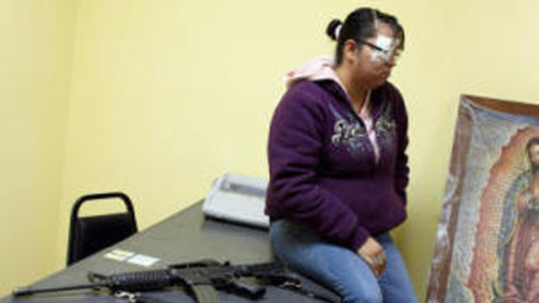 Erika Gandara, 28, is shown at her office at the police station in Guadalupe.