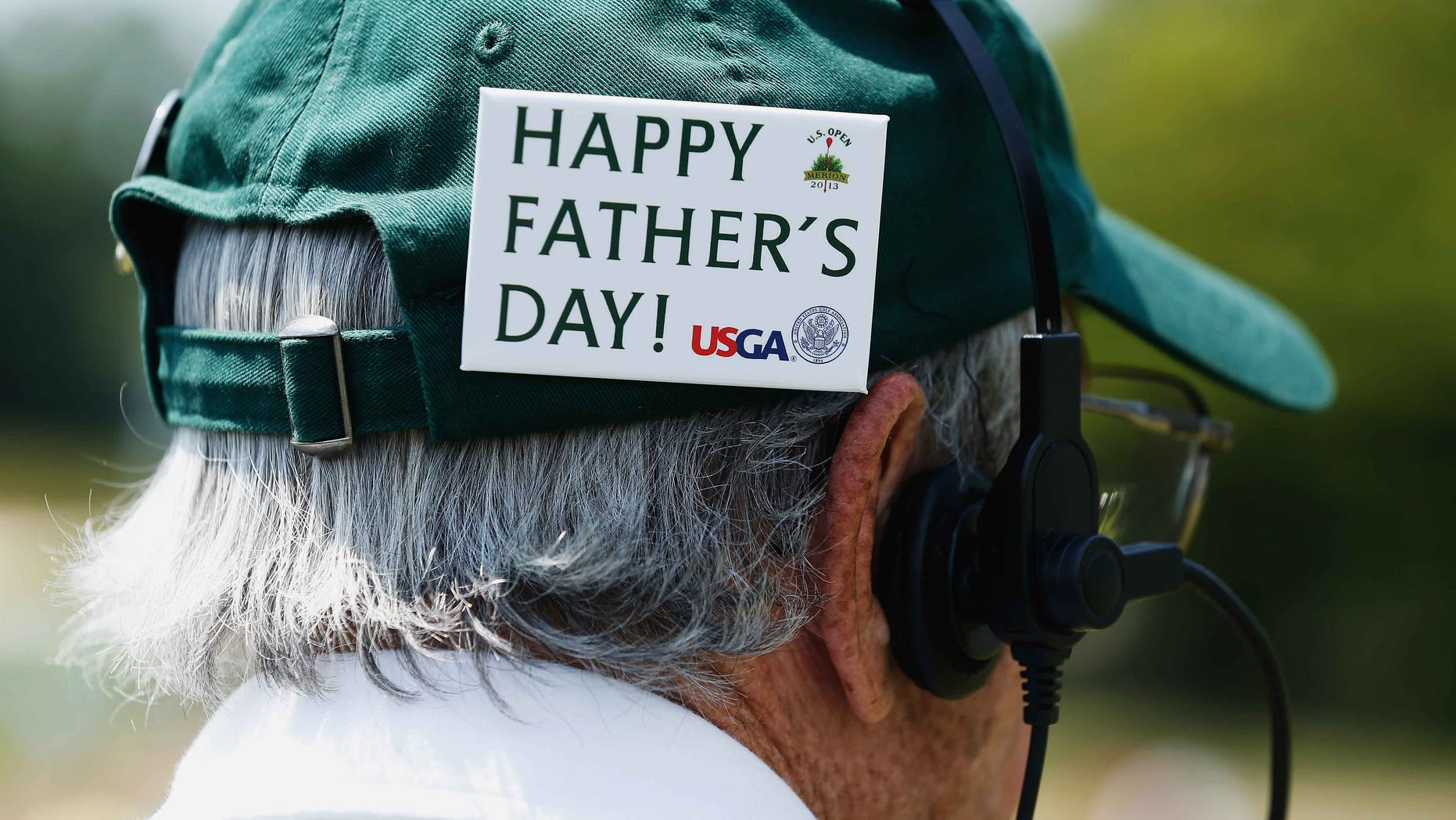 "ARDMORE, PA - JUNE 16: A man wears a badge on his hat that says ""Happy Father's Day"" during the final round of the 113th U.S. Open at Merion Golf Club on June 16, 2013 in Ardmore, Pennsylvania.  (Photo by Scott Halleran/Getty Images)"
