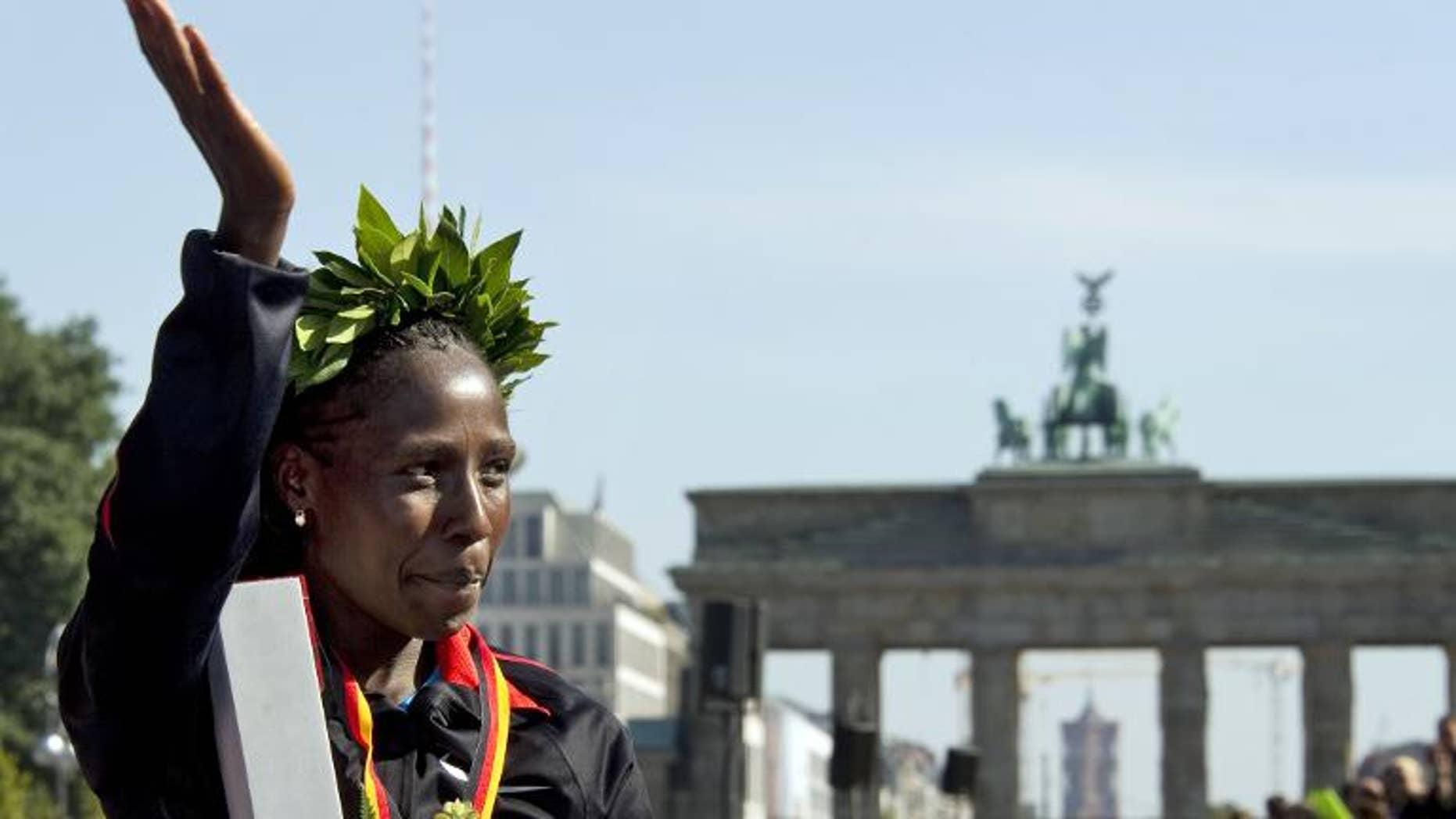 Florence Kiplagat of Kenya celebrates after the 38th Berlin Marathon on September 25, 2011