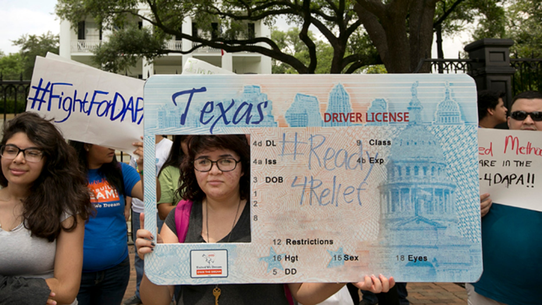 Alondra Chavez, 17, of Pasadena, Texas, and other immigrant rights activists protest outside the Governor's Mansion in Austin, Texas, on Tuesday May 19, 2015. The group was protesting the Texas lawsuit against the Deferred Action for Parents of Americans, also known as DAPA, which would have gone into effect on Tuesday.   (Jay Janner/Austin American-Statesman via AP)