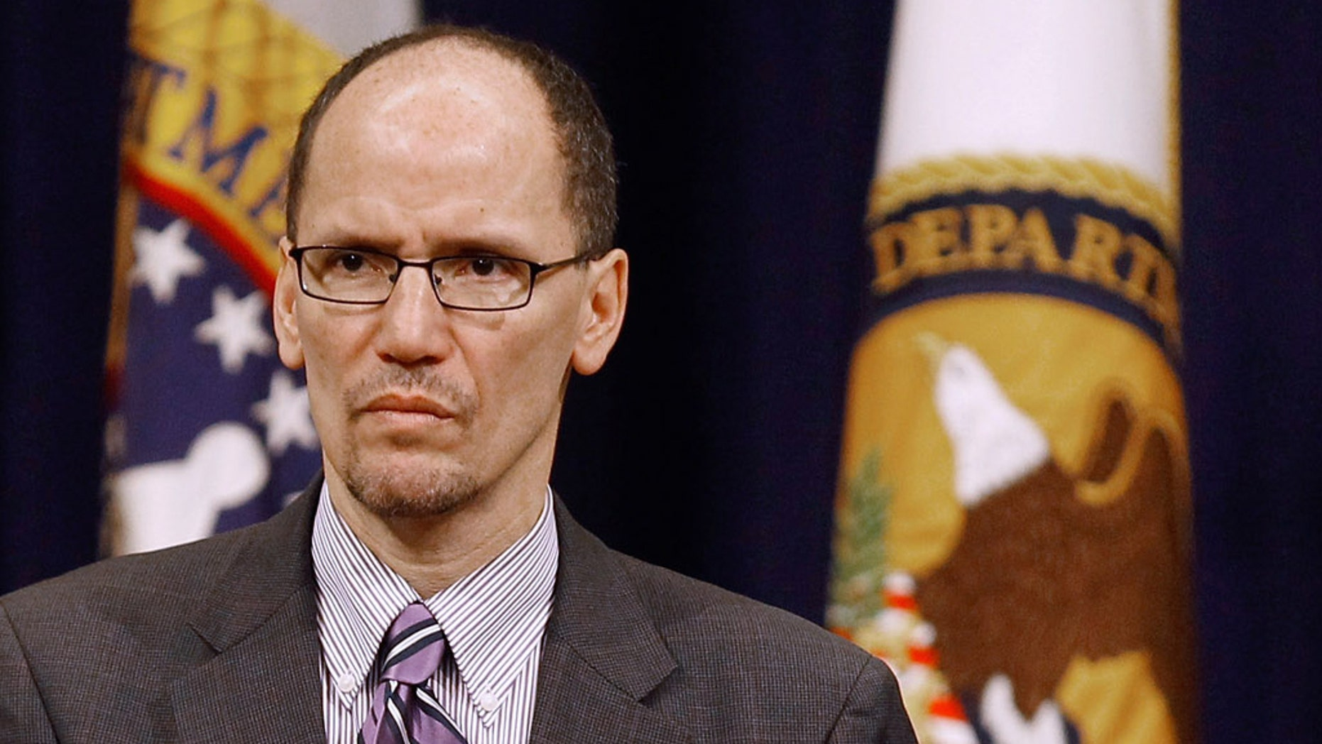 Assistant Attorney General for Civil Rights Thomas Perez listens to the Star Spangled Banner during the Dr. Martin Luther King, Jr. Commemorative Program at the Department of Justice January 11, 2011.
