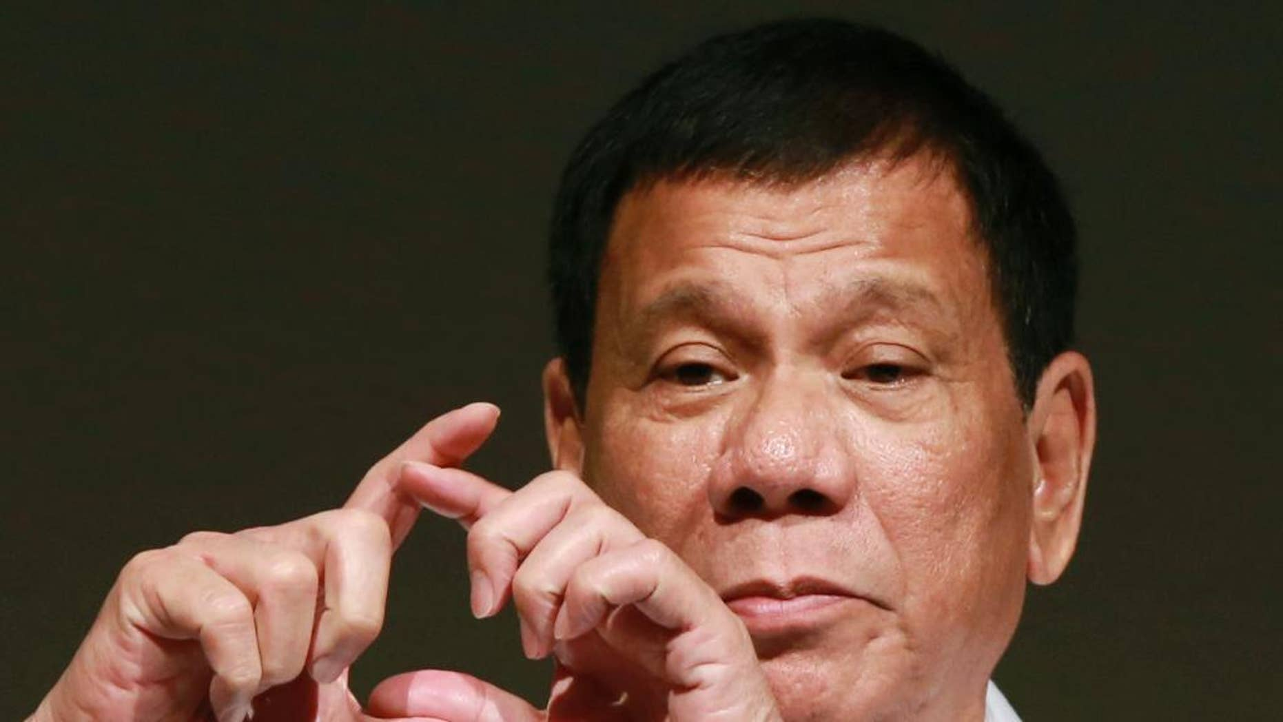 """FILE - In this Oct. 26, 2016, file photo, Philippine President Rodrigo Duterte delivers a speech at the Philippine Economic Forum in Tokyo. Duterte telephoned U.S. President-elect Donald Trump late Friday, Dec. 2 and had a brief but """"very engaging, animated conversation"""" in which both leaders invited each other to visit his country.  In a video released by Duterte's close aide, Bong Go, the Philippine leader is seen smiling while talking to Trump late Friday and saying: """"We will maintain ... and enhance the bilateral ties between our two countries.""""  (AP Photo/Eugene Hoshiko, File)"""
