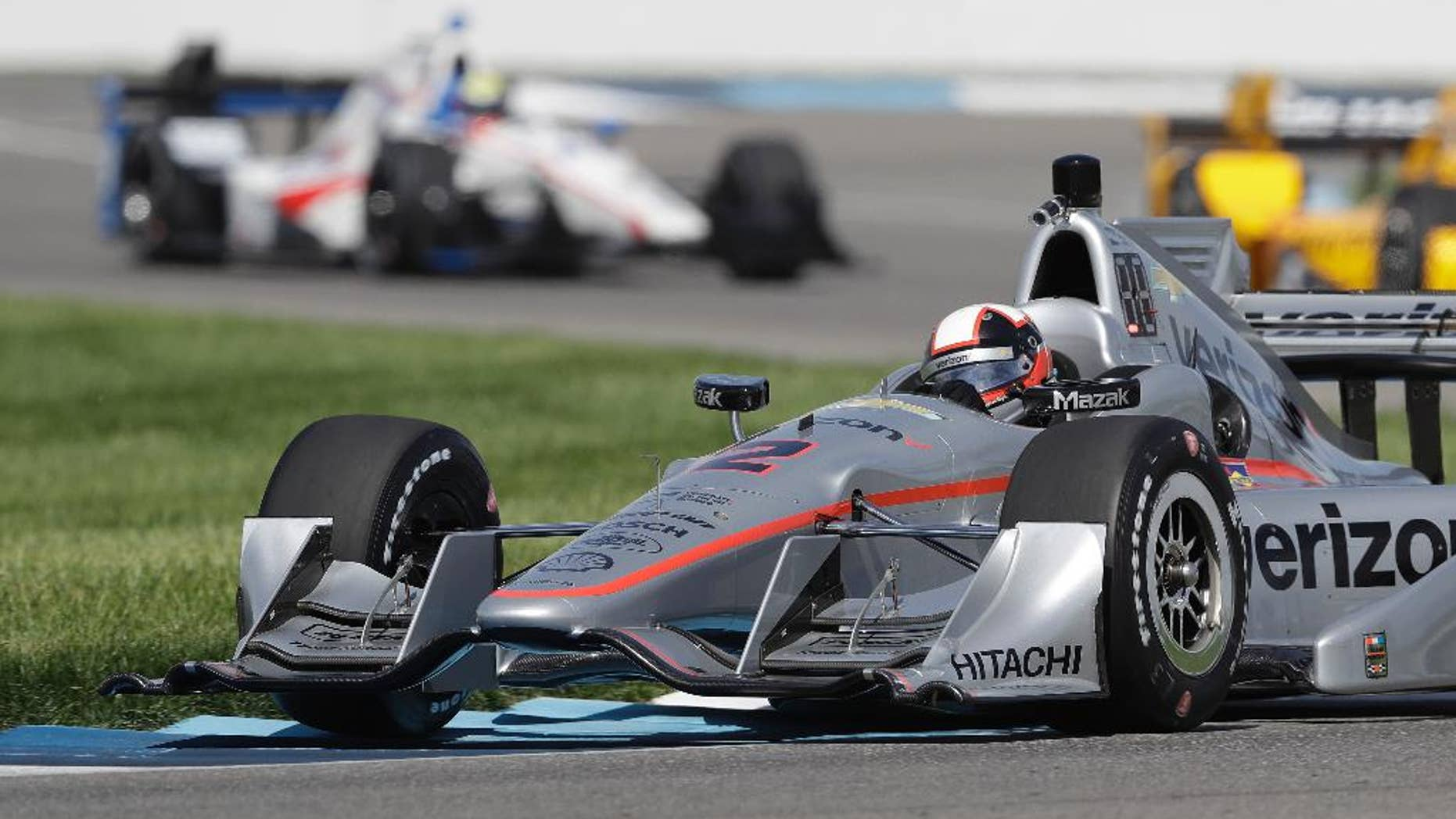 Juan Pablo Montoya, of Colombia, steers his car during practice session for the Grand Prix of Indianapolis auto race at Indianapolis Motor Speedway in Indianapolis, Thursday, May 12, 2016. (AP Photo/Darron Cummings)