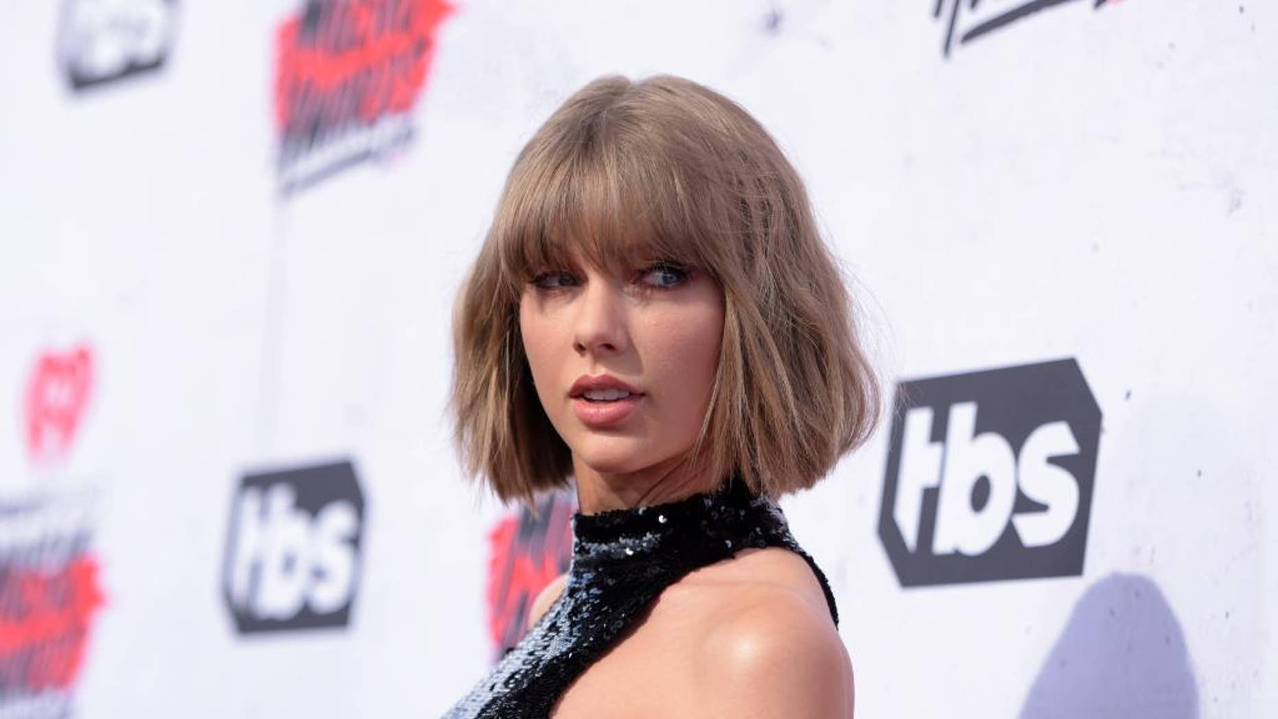"""FILE - In this April 3, 2016 file photo, Taylor Swift arrives at the iHeartRadio Music Awards at The Forum in Inglewood, Calif. Swift is donating $1 million to Louisiana after torrential rains caused massive flooding in the state and killed at least 11 people. Swift told The Associated Press on Tuesday, Aug. 16, 2016, that the community in Louisiana """"made us feel completely at home"""" when she and her touring crew kicked off the U.S. dates of her """"1989 World Tour"""" in the state last year. (Photo by Richard Shotwell/Invision/AP, File)"""