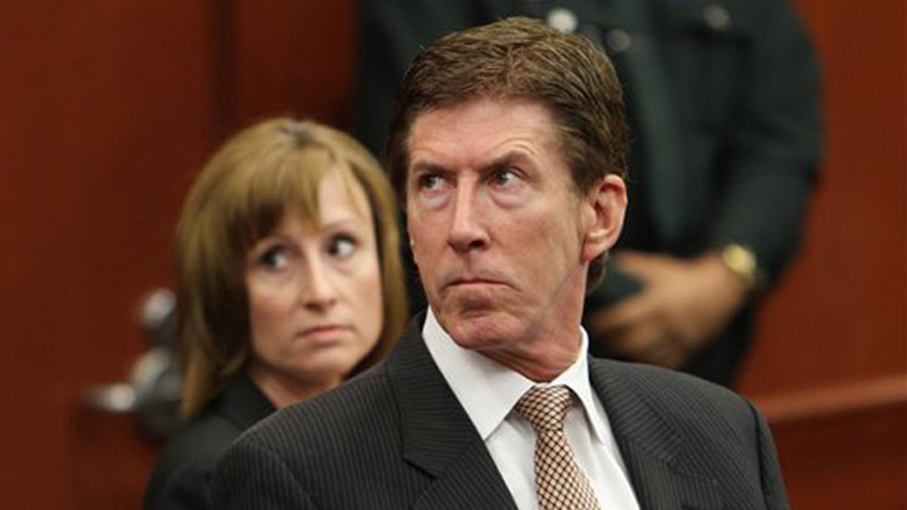 April 27, 2012: Attorney Mark O'Mara, right, and associate Lorna Truett appear in court on behalf of their client George Zimmerman during a hearing in his trial in Sanford, Fla.