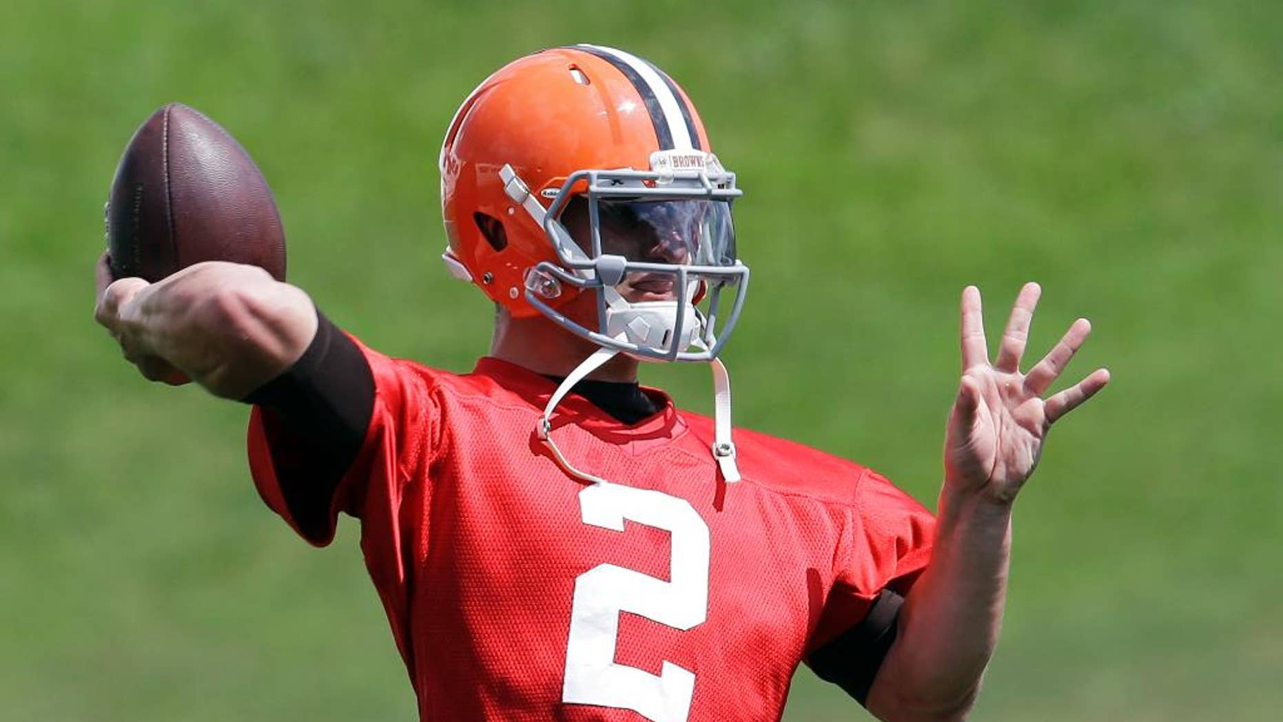 Cleveland Browns quarterback Johnny Manziel passes during practice at the NFL football team's facility in Berea, Ohio Wednesday, Sept. 3, 2014. Manziel begins the 2014 season on the bench behind starter Brian Hoyer. (AP Photo/Mark Duncan)