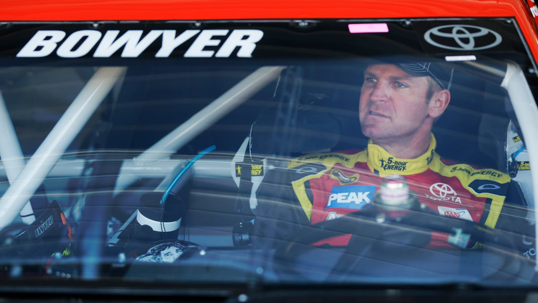 FILE - In this April 19, 2013 file photo, Clint Bowyer waits for the start of practice for the NASCAR Sprint Cup series auto race at Kansas Speedway in Kansas City, Kan. Bowyer was always popular among his peers. A change of scenery to Michael Waltrip Racing has now made him one of NASCAR's stars.  (AP Photo/Orlin Wagner, File)
