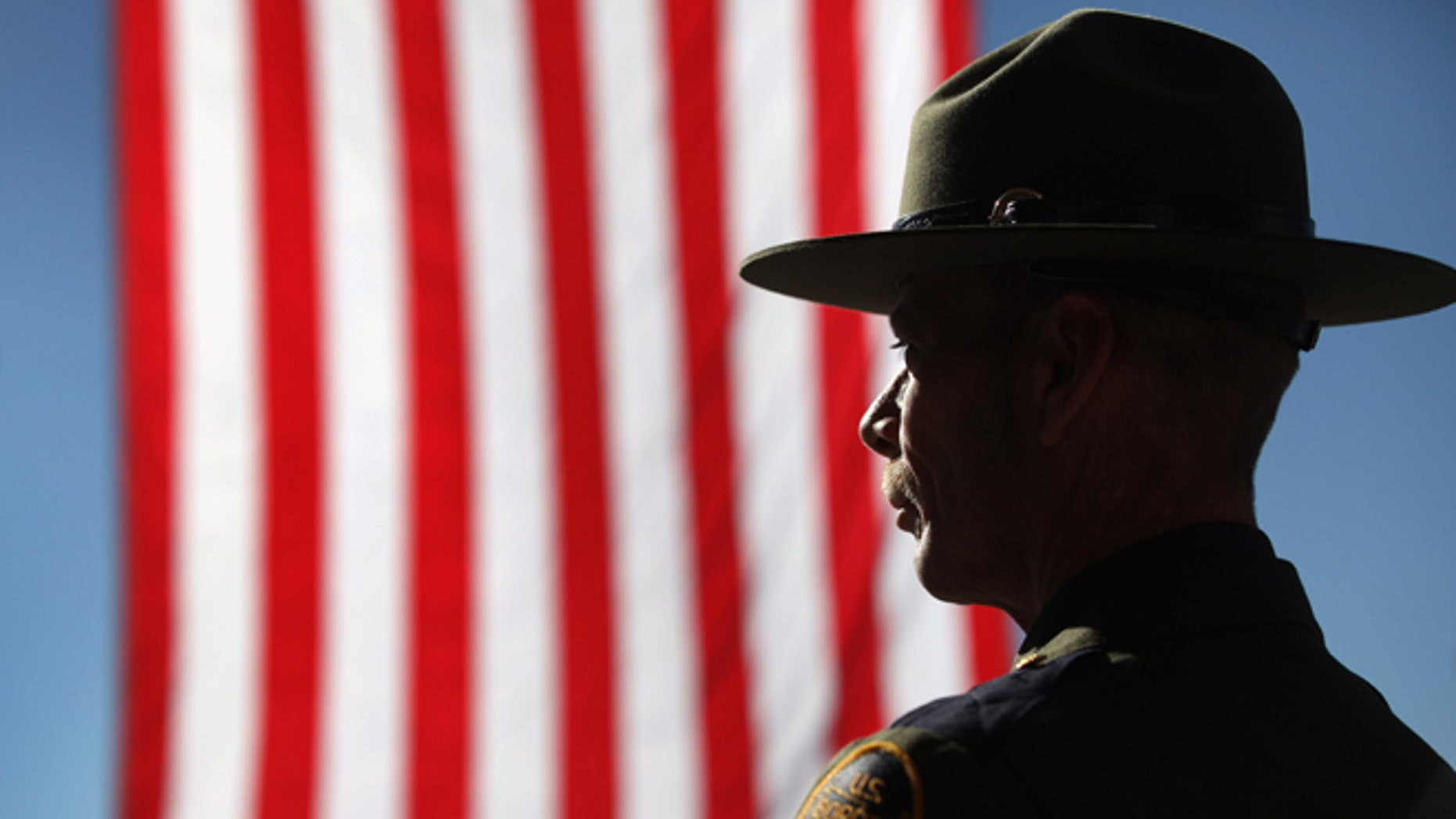 TUCSON, AZ - JANUARY 21:  U.S. Border Patrol agent Michael Wagenen attends a memorial service for slain comrade Brian Terry on January 21, 2011 in Tucson, Arizona. Agent Terry was killed during a December14 shootout with suspected bandits near the U.S.-Mexico Border. Thousands of Border Patrol agents and fellow law enforcement officers from across Arizona turned out for the memorial service held at Kino baseball stadium in Tucson. With U.S. agents tracking drug smugglers and illegal immigrants all along the border, the region has become one of the most militarized areas of the United States.  (Photo by John Moore/Getty Images)