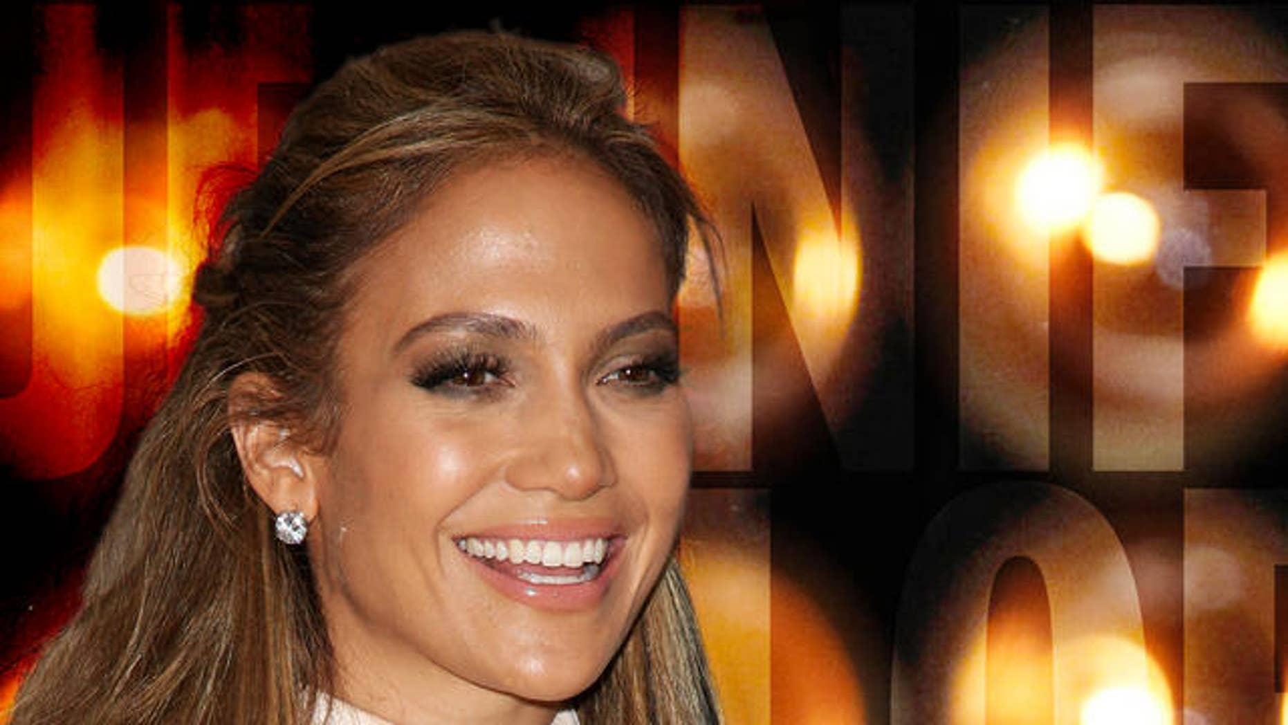 """Actress Jennifer Lopez makes an appearance at Macy's Herald Square as part of Fashion Night Out and also to promote her new fragrance """"Love and Glamour"""", in New York, on Friday, Sept. 10, 2010. (AP Photo/Peter Kramer)"""