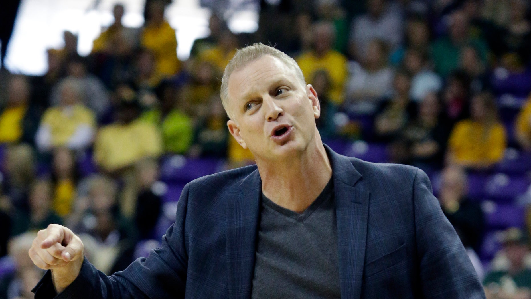TCU head coach Jeff Mittie  gestures from the sideline during the first half of an NCAA college basketball game against the Baylor Saturday, Feb. 22, 2014, in Fort Worth, Texas. (AP Photo/LM Otero)