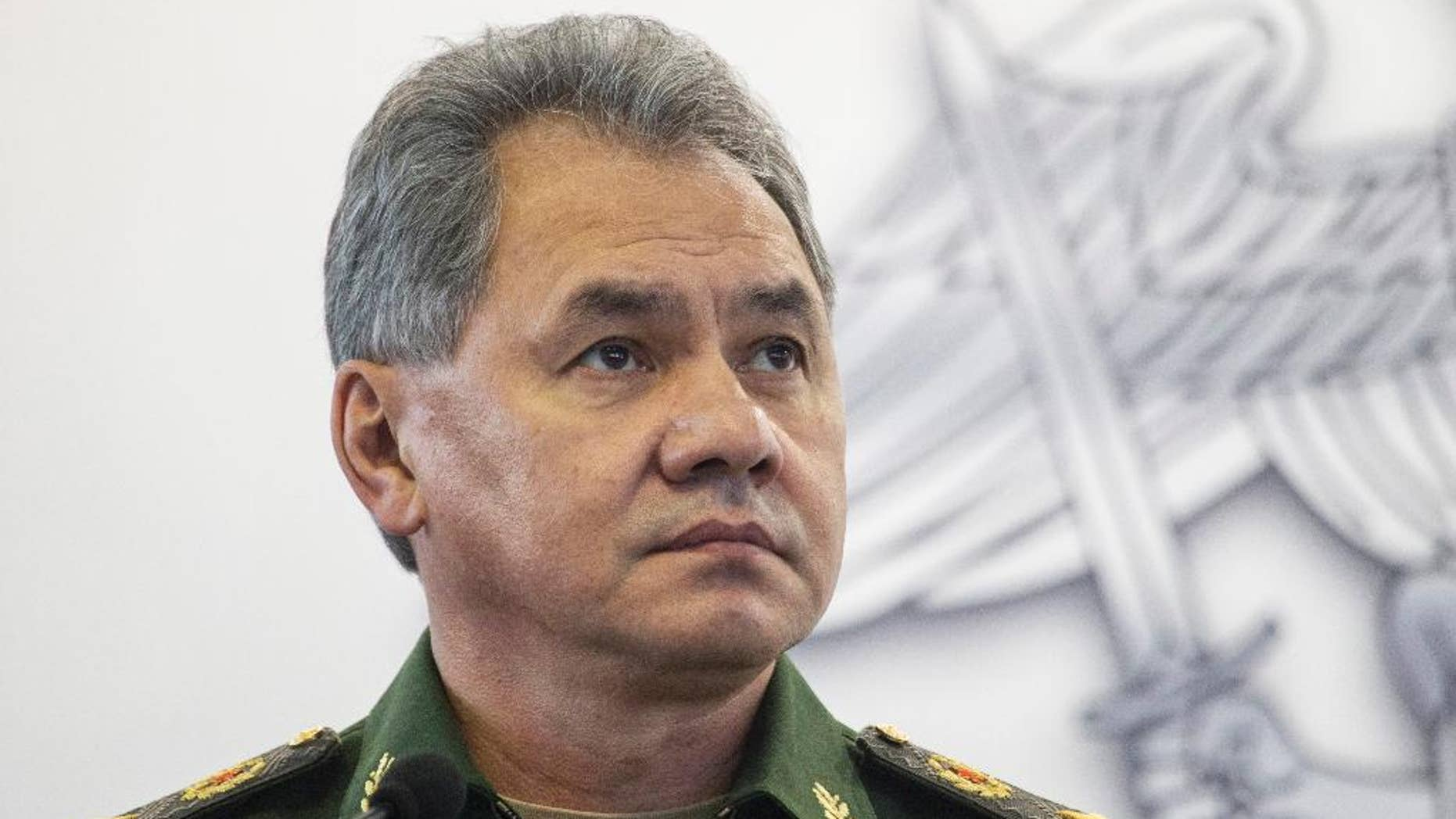 FILE  In this file photo taken on Monday, Oct.  5, 2015, Russian Defence Minister Sergei Shoigu attends an opening ceremony during an Innovation exhibition of the Russian Defense Ministry in Kubinka outside Moscow, Russia. Shoigu said Friday, March 25, 2016 that NATO's moves to build up its military forces near Russia's borders has caused Moscow's concern and required a response. (AP Photo/Pavel Golovkin, File)