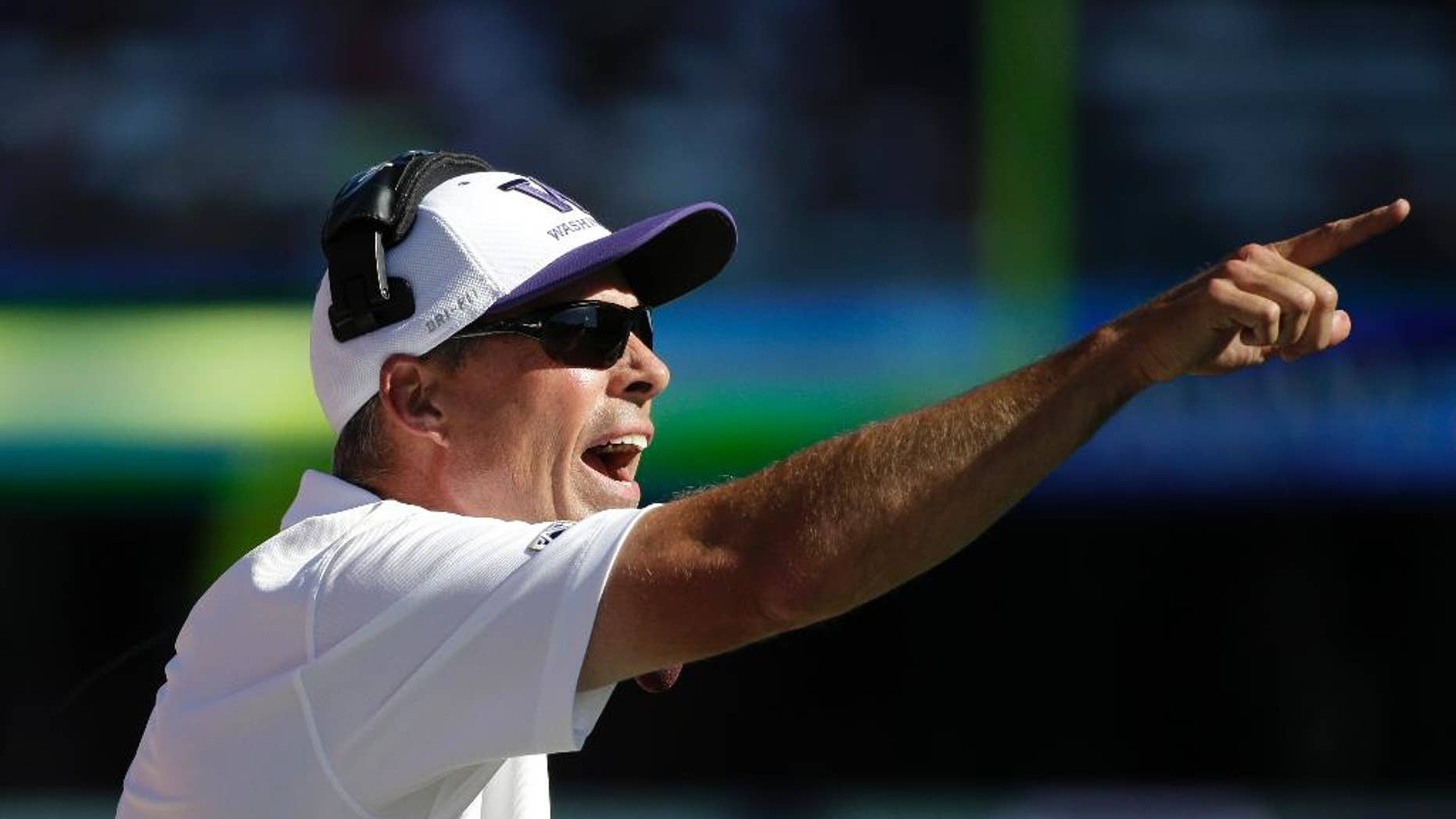 Washington Huskies head coach Chris Petersen yells toward the field in the second half of an NCAA football game Saturday, Sept. 6, 2014, in Seattle. Washington won 59-52. (AP Photo/Elaine Thompson)