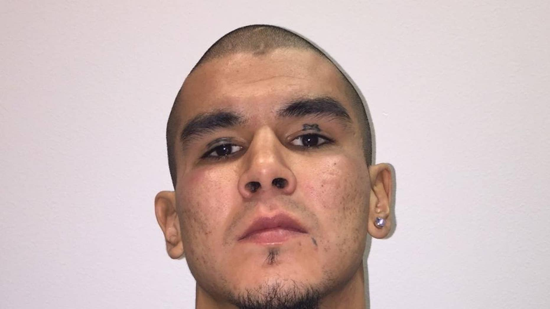 This photo released by Fairbanks Police Department shows Anthony George Jenkins-Alexie. The 29-year-old man was arrested in a shooting that left an Alaska police officer seriously injured. Jenkins-Alexie, of Fairbanks, is facing charges of attempted murder, assault and other counts in connection with the shooting early Sunday of Sgt. Allen Brandt. (Fairbanks Police Department  via AP)