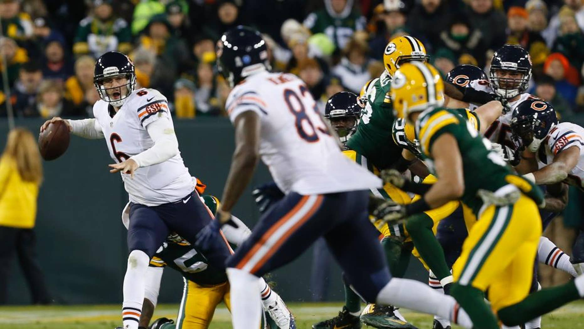 Chicago Bears quarterback Jay Cutler (6) looks to throw a pass to tight end Martellus Bennett (83) during the second half of an NFL football game against the Green Bay Packers Sunday, Nov. 9, 2014, in Green Bay, Wis. The pass in this play was incomplete. (AP Photo/Mike Roemer)