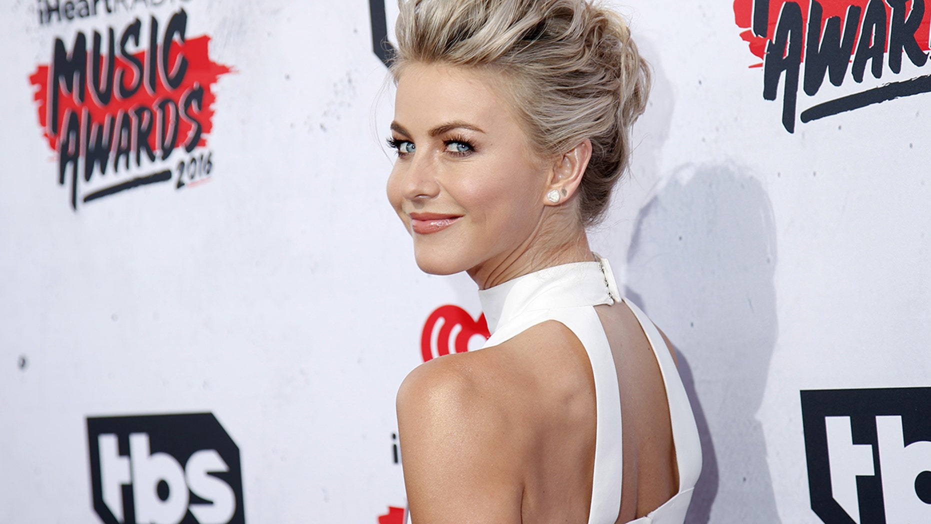 Dancer and actress Julianne Hough poses at the 2016 iHeartRadio Music Awards in Inglewood, California, April 3, 2016.