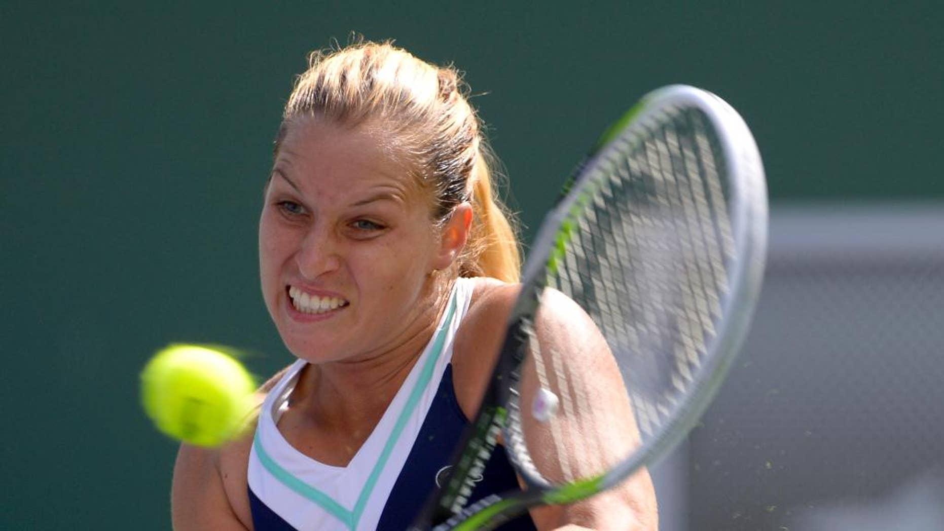 Dominika Cibulkova, of Slovakia, returns a shot to Li Na, of China, during a quarterfinal match at the BNP Paribas Open tennis tournament, Thursday, March 13, 2014 in Indian Wells, Calif. (AP Photo/Mark J. Terrill)