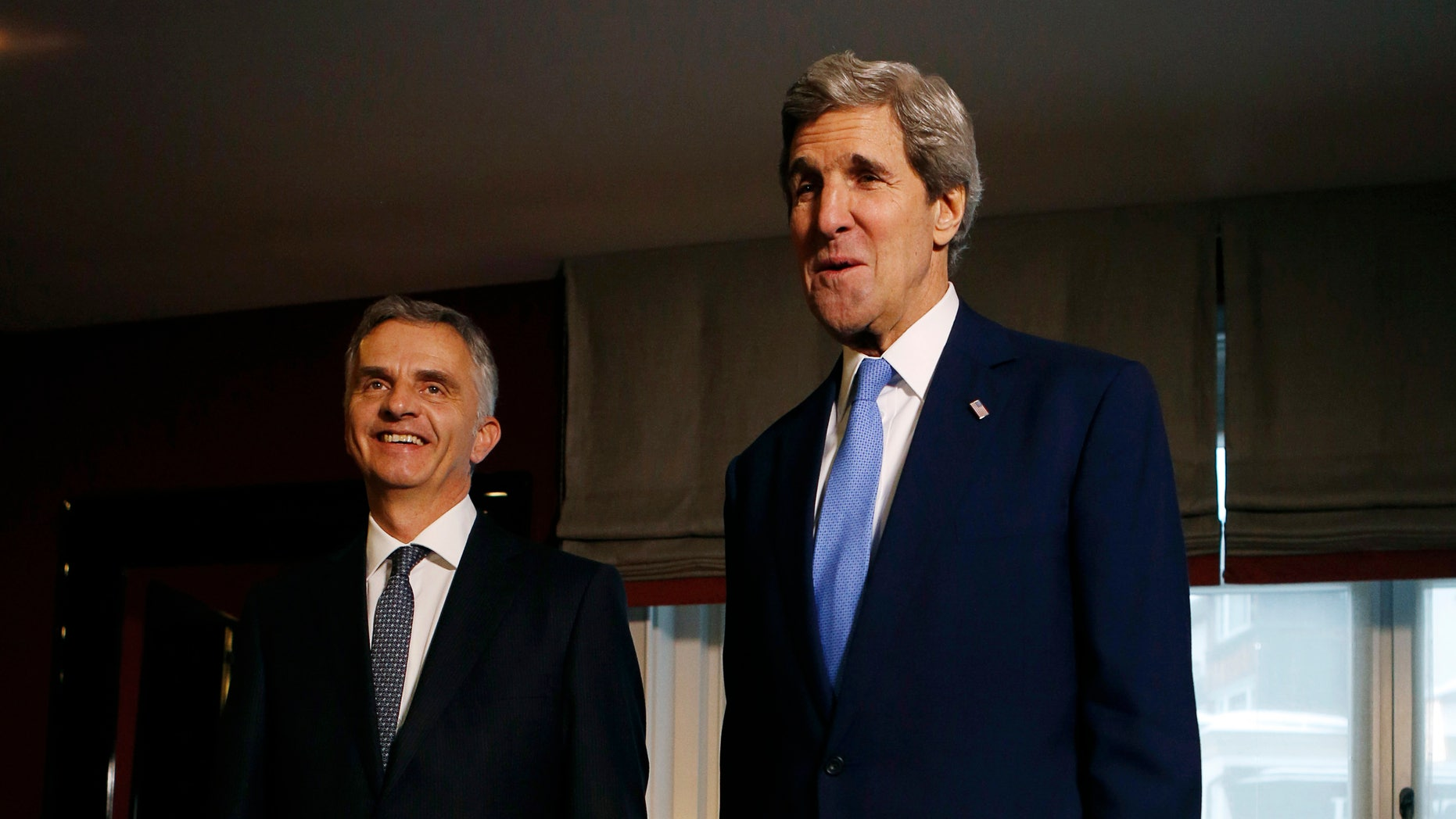U.S. Secretary of State John Kerry, right, poses with Swiss President Didier Burkhalter for photographers in Davos, Switzerland, Friday, Jan. 24, 2014. Kerry is attending the annual World Economic Forum meeting in the Swiss Alps. (AP Photo/Gary Cameron, Pool)