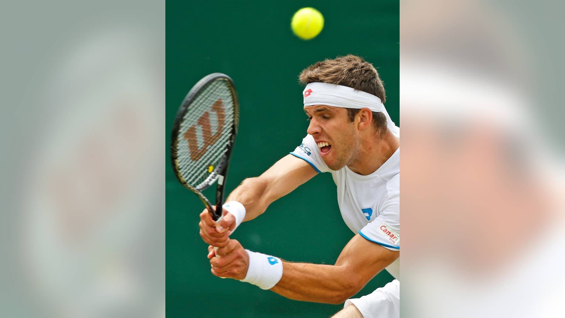 Jiri Vesely of the Czech Republic plays a return to Gael Monfils of France during their men's singles match at the All England Lawn Tennis Championships in Wimbledon, London, Thursday, June 26, 2014. (AP Photo/Sang Tan)
