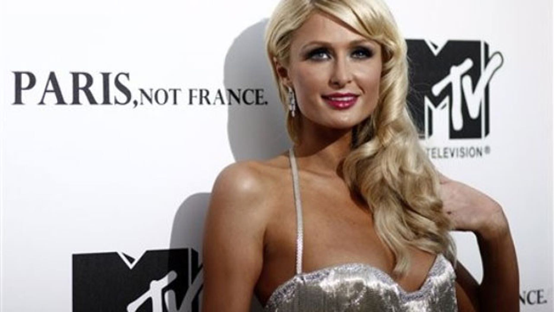 Paris Hilton is being sued by a fake hair company who pays her as a spokeswoman after she was spotted in a competitor's weave.