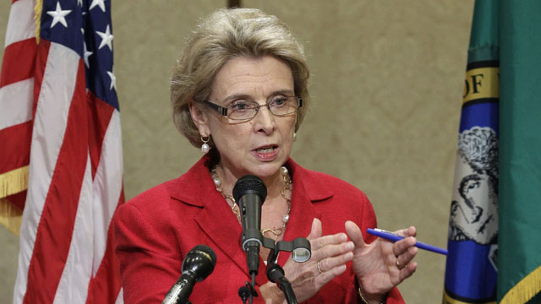 November 21, 2011: Washington Gov. Chris Gregoire talks to reporters about her proposal to address a projected $1.4 billion deficit at the state Capitol in Olympia, Wash.