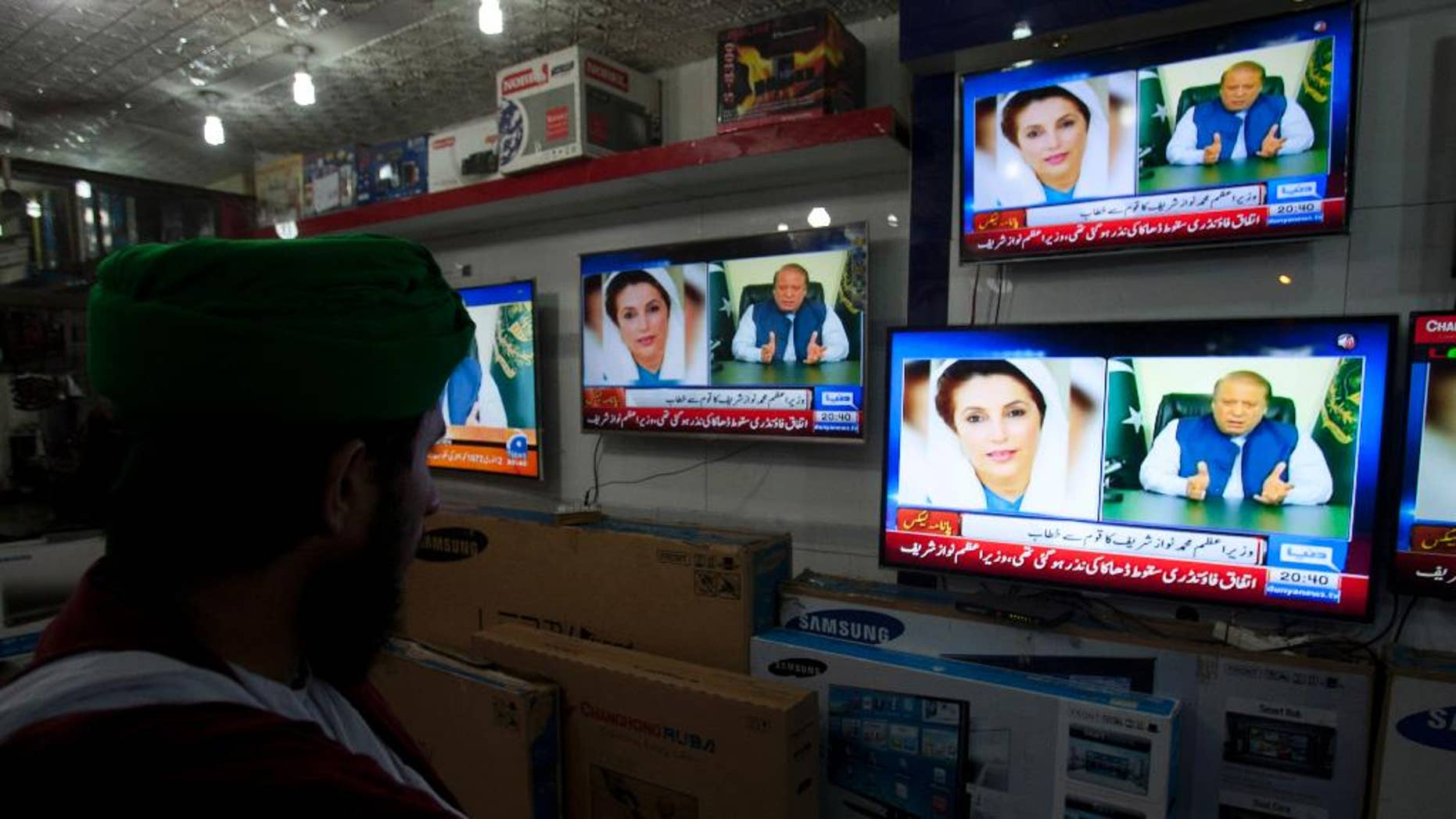 A man watches a televised address of Pakistan's Prime Minister Nawaz Sharif at an electronic shop in Karachi, Pakistan, Tuesday, April 5, 2016. Sharif has announced that he will set up an independent judicial commission to probe whether his family is involved in illegal overseas investments after reports based on documents leaked from a Panama-based law firm indicated his sons owned several offshore companies. (AP Photo/Shakil Adil)