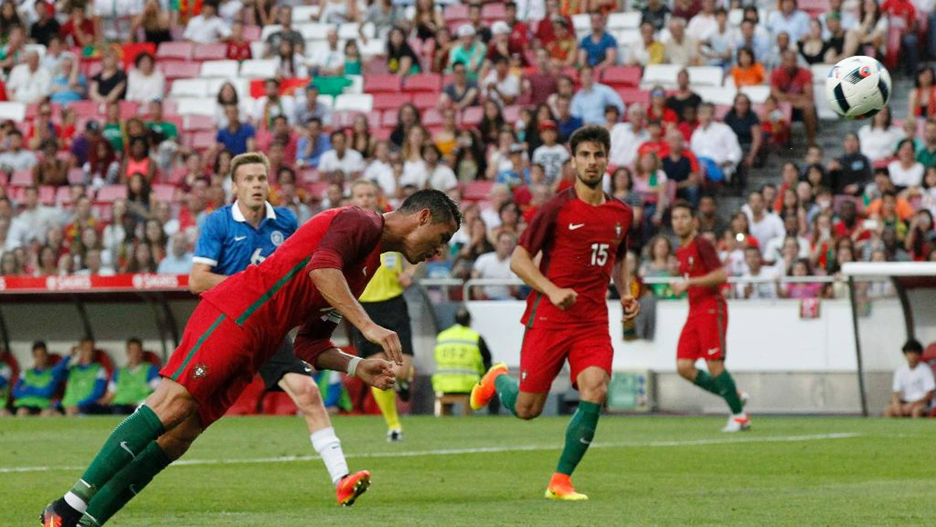 FILE - In this June 8, 2016, file photo, Portugal's Cristiano Ronaldo heads the ball to score against Estonia during a friendly soccer match in Lisbon, Portugal. American soccer fans can watch a quintuple-header of major international tournament matches Saturday, the first of six in the next week-and-a-half.  (AP Photo/Steven Governo, File)