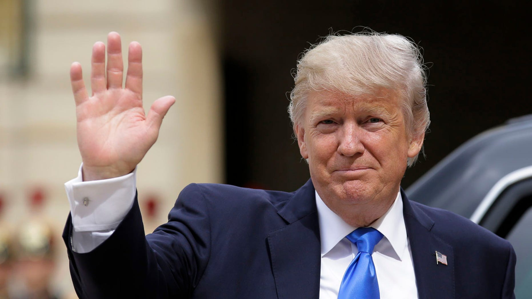 US President Donald Trump waves as he arrives for a meeting with French President Emmanuel Macron at the Elysee Palace in Paris, Thursday, July 13, 2017.