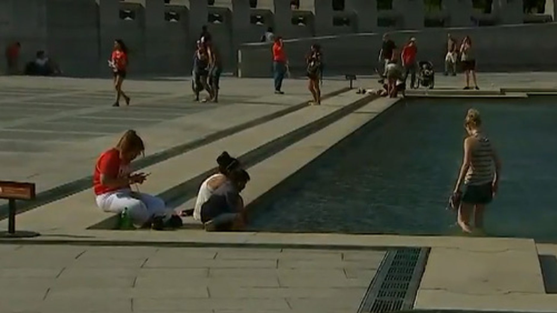 July 2016: Visitors to the National World War II Memorial, Washington, D.C. Fox 5 News