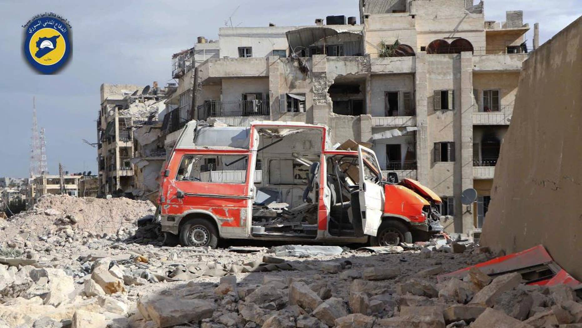 Sept. 23, 2016: In this photo provided by the Syrian Civil Defense group known as the White Helmets, a destroyed ambulance is seen outside the Syrian Civil Defense main center after airstrikes in Ansari neighborhood in the rebel-held part of eastern Aleppo, Syria.