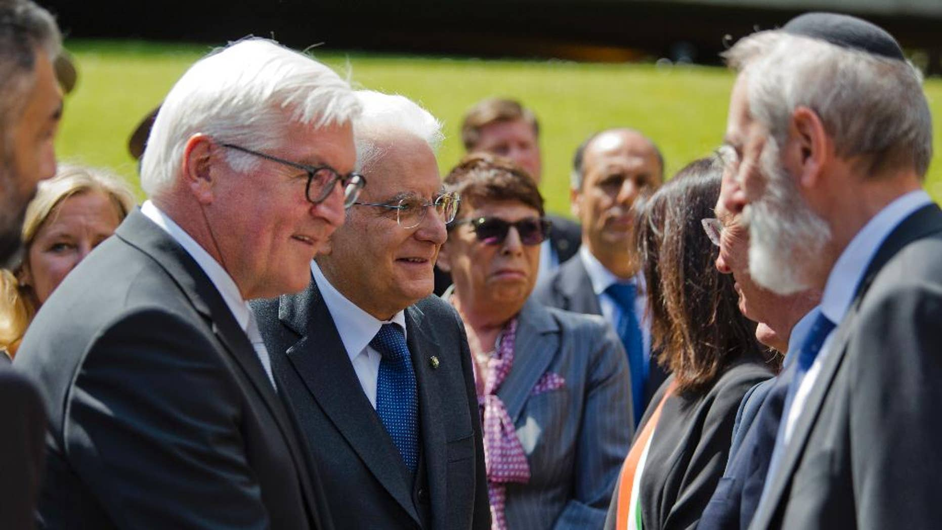 German President Frank-Walter Steinmeier, left, flanked by his Italian counterpart Sergio Mattarella, shakes hands with Rome's Chief Rabbi Riccardo Di Segni during a visit to the Fosse Ardeatine Memorial Cemetery in Rome, built on the site of a mass killing of 365 civilians during World War II by the occupying Nazis as a reprisal for a partisan attack the previous day, Wednesday, May 3, 2017. (AP Photo/Domenico Stinellis)