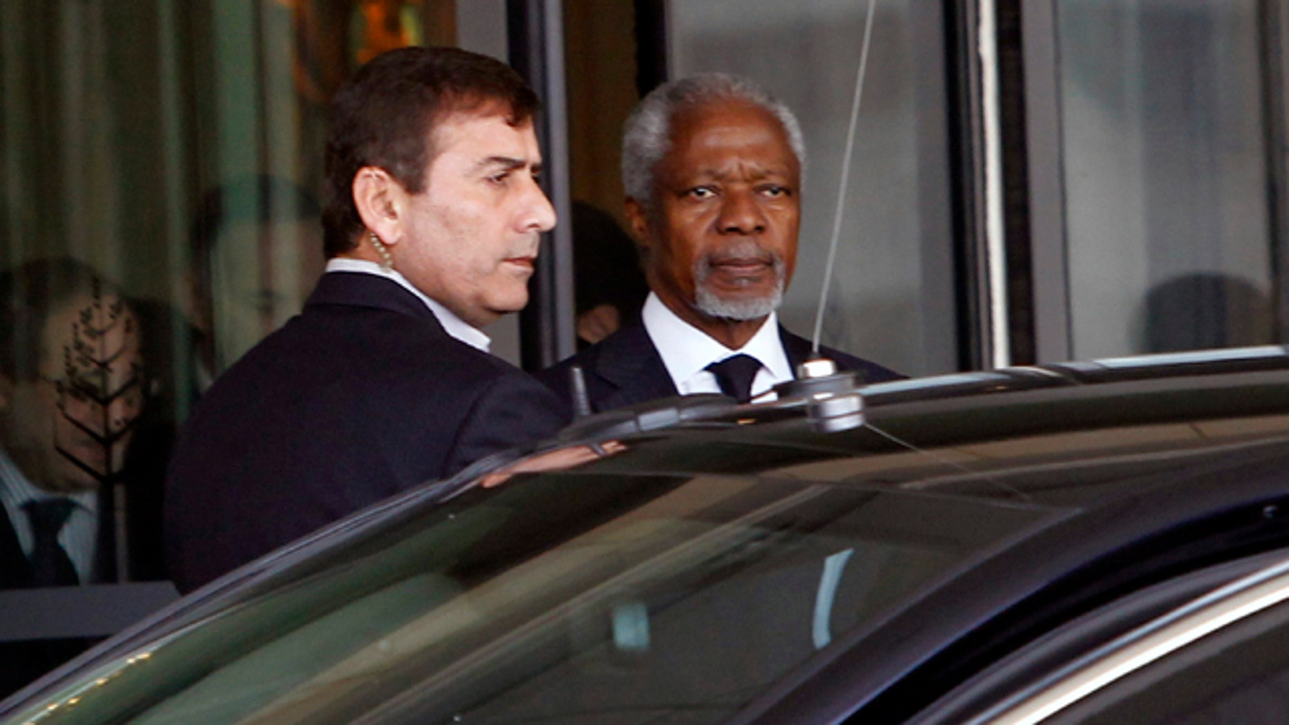 March 10, 2012: Kofi Annan, the United Nations special envoy to Syria, center, leaves the Four Seasons Hotel in Damascus, Syria on his way to the presidential palace for a meeting with Syrian President Bashar Assad.