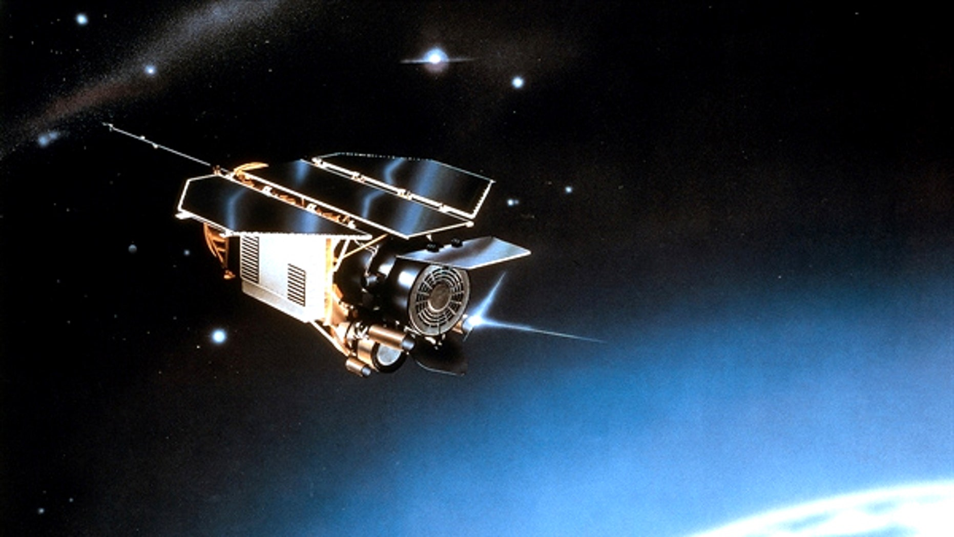 An artist's impression of the German ROSAT satellite orbiting in space.