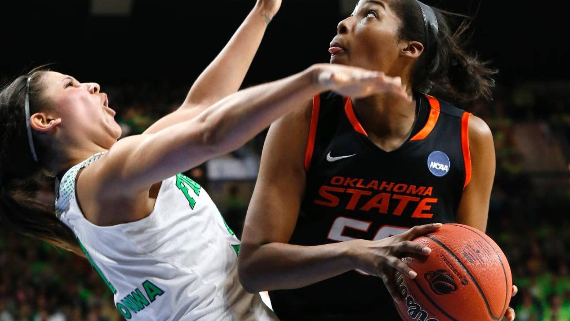 Oklahoma State center LaShawn Jones (55) drives against Notre Dame forward Natalie Achonwa (11) during the second half of of a regional semifinal in the NCAA college basketball tournament at the Purcell Pavilion in South Bend, Ind., Saturday, March 29, 2014. (AP Photo/Paul Sancya)