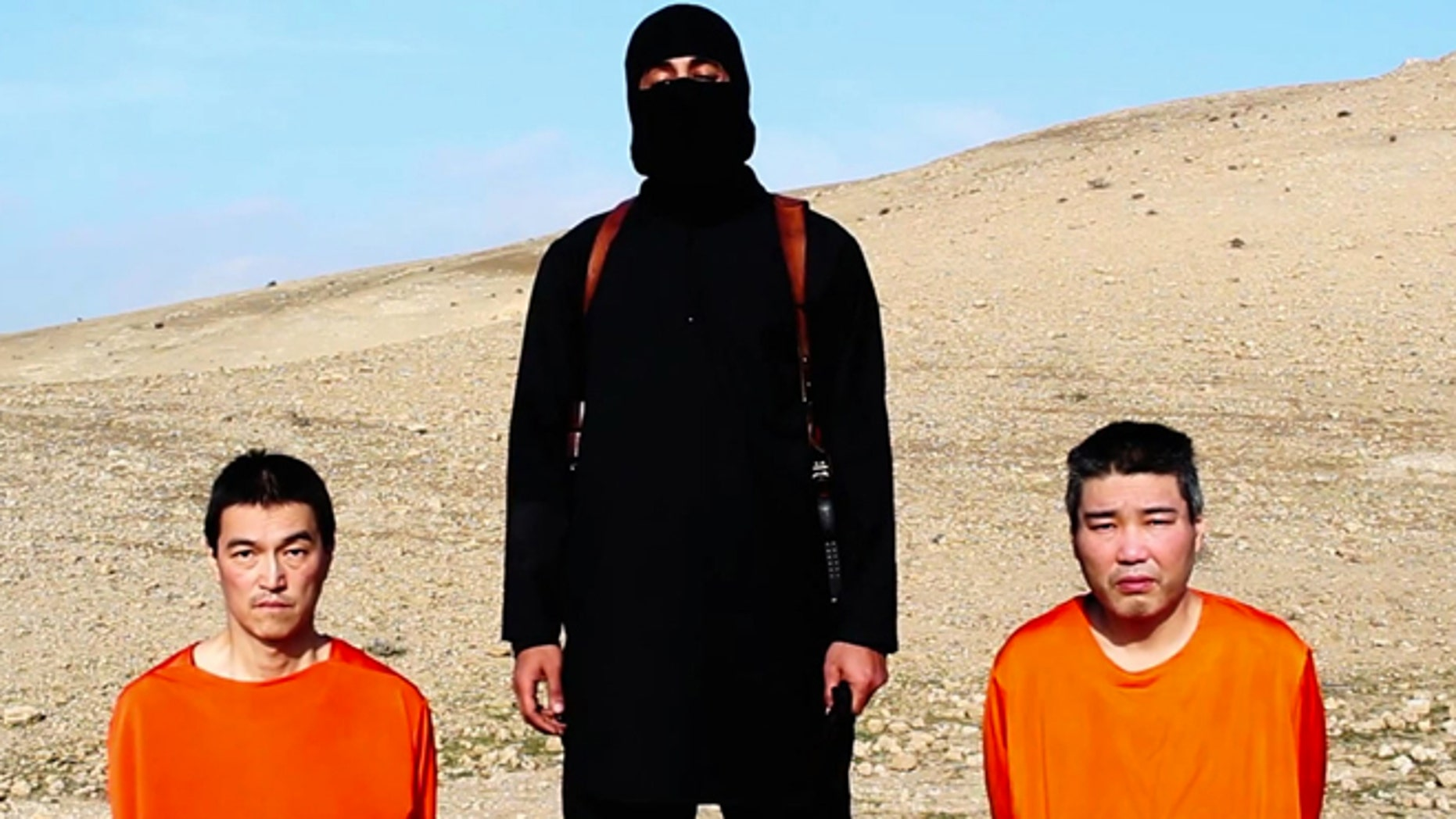 Jan. 20, 2015: This image taken from an online video released by the Islamic State's al-Furqan media arm, purports to show the group threatening to kill two Japanese hostages that the militants identify as KenjiGoto Jogo, left, and Haruna Yukawa, right, unless a $200 million ransom is paid within 72 hours.