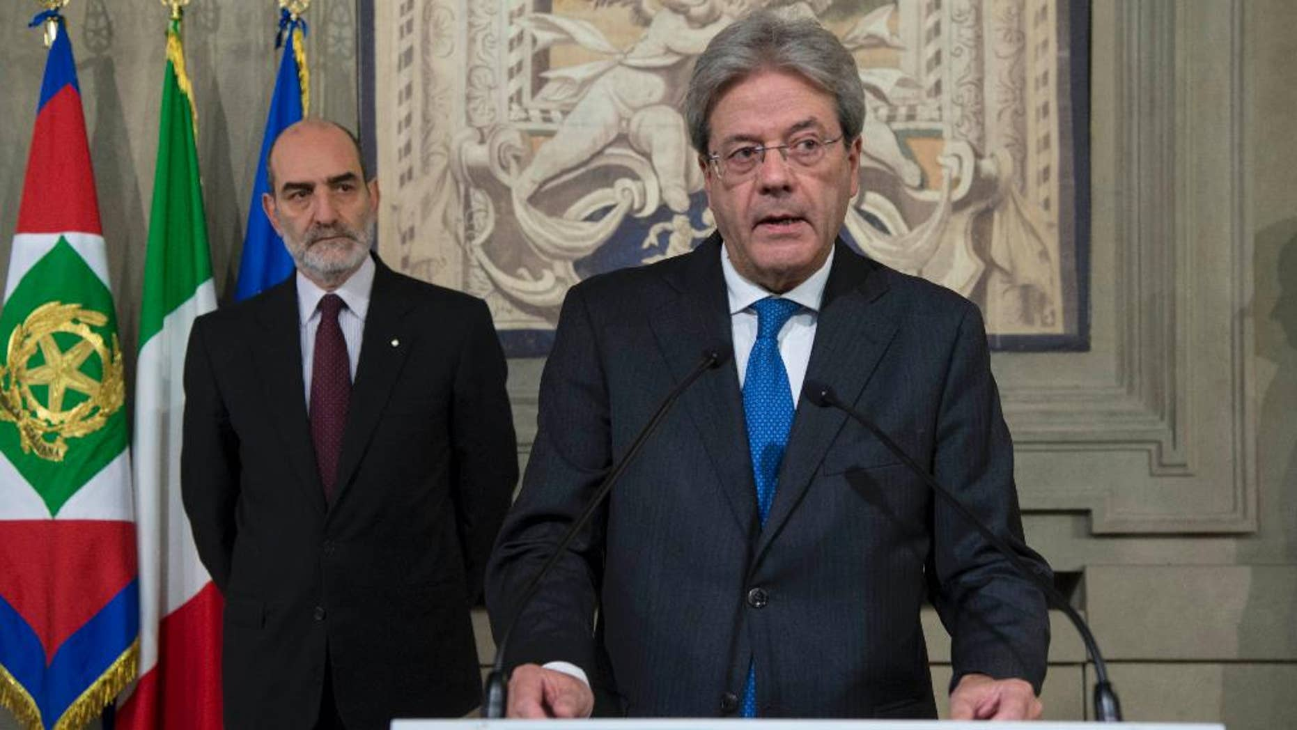 Paolo Gentiloni speaks at the Quirinale presidential palace, in Rome Sunday, Dec. 11, 2016. New Italian Premier-designate Paolo Gentiloni says he'll try to form Italy's new government as soon as possible. (Francesco Ammendola/Italian Presidency via AP)